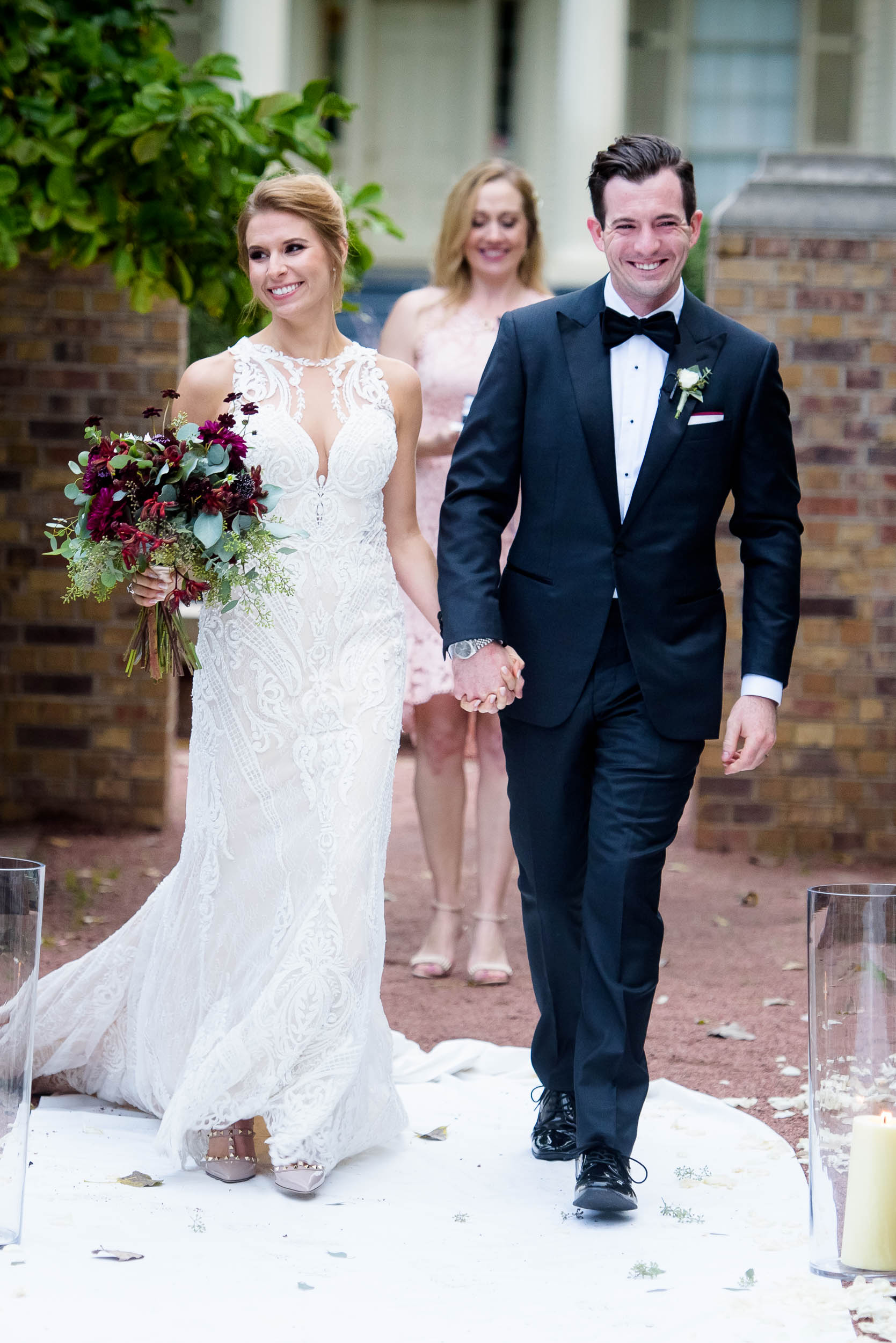 Bride and groom walk down the aisle during a Glessner House Chicago wedding ceremony.
