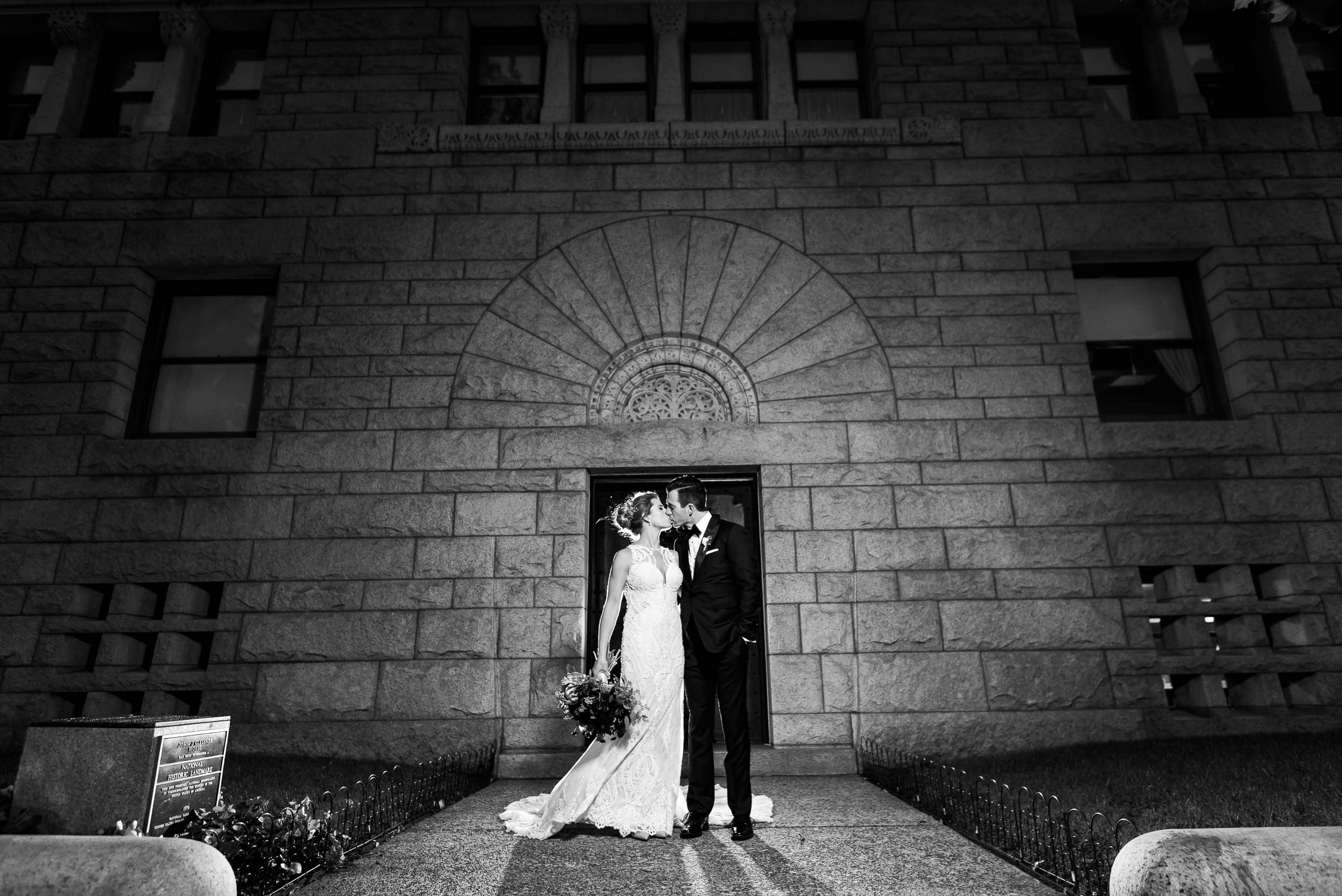 Creative night portrait of the bride and groom during their Glessner House Chicago wedding.