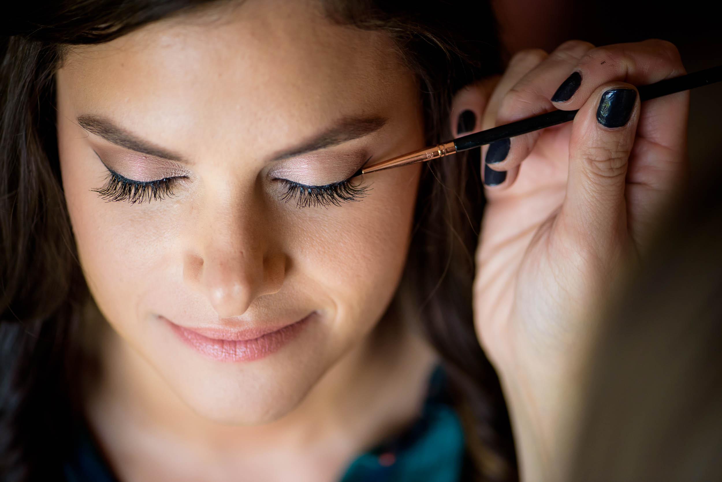 Bride getting wedding makeup done for Grand Geneve Resort Fall Chicago Wedding captured by J. Brown Photography. Visit jbrownphotography.com for more wedding inspiration!