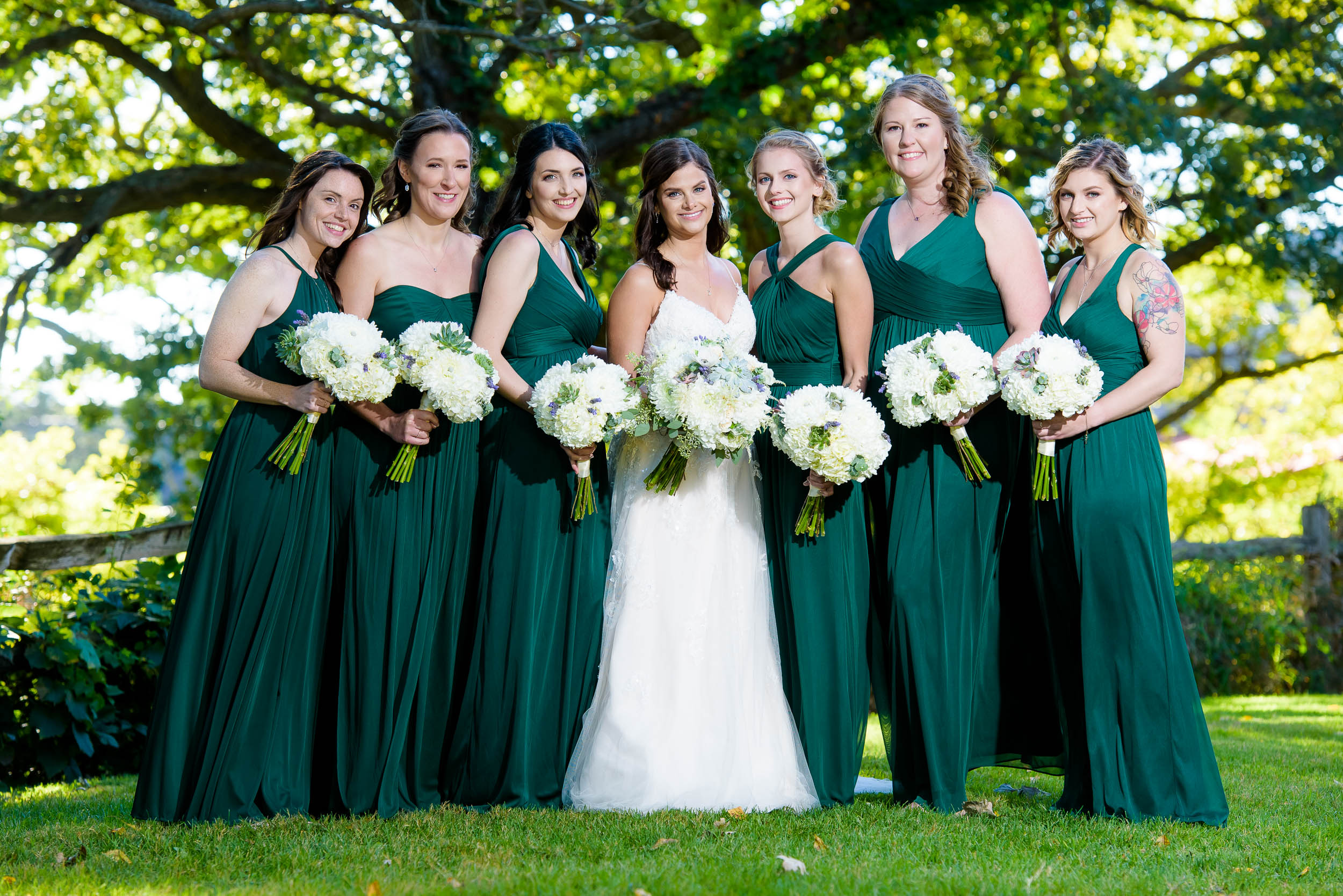 Green bridesmaids dresses for Grand Geneve Resort Fall Chicago Wedding captured by J. Brown Photography. Visit jbrownphotography.com for more wedding inspiration!