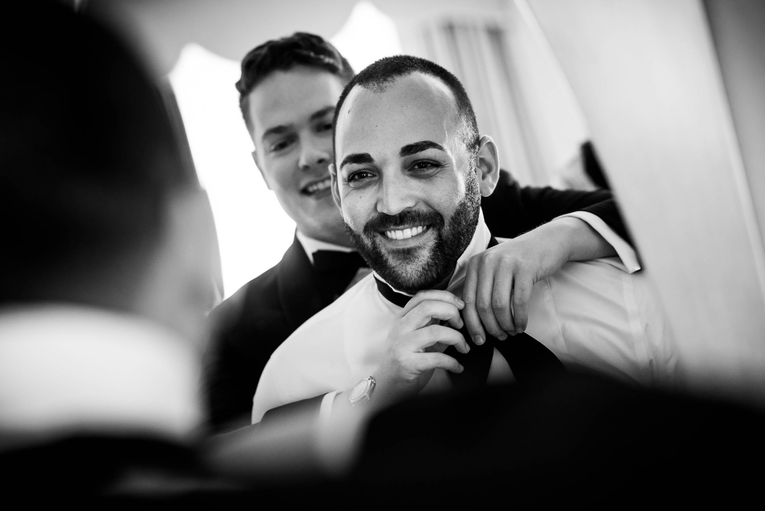 Grooms getting ready for luxurious fall wedding at the Chicago Symphony Center captured by J. Brown Photography. See more wedding ideas at jbrownphotography.com!