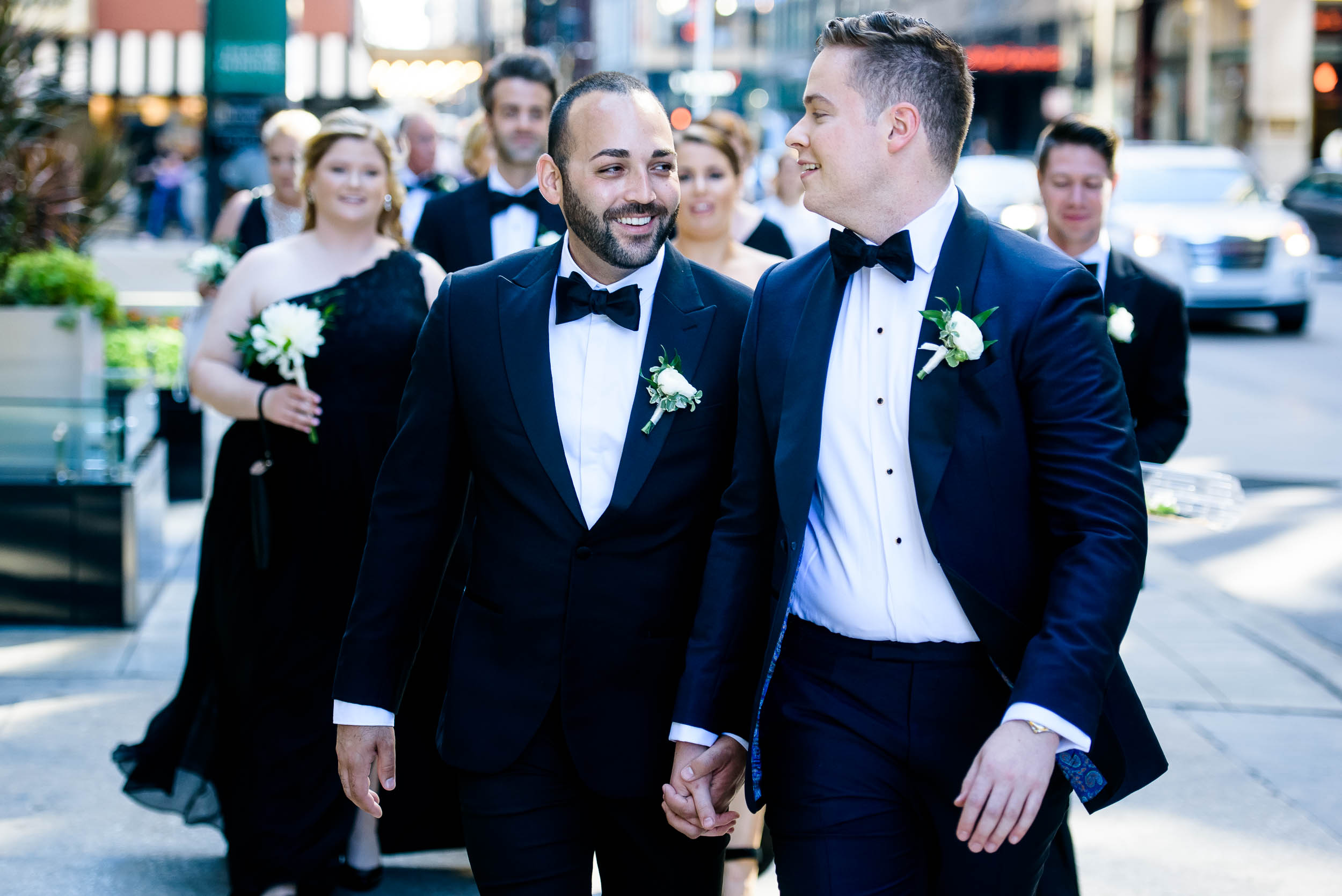Wedding party photos for luxurious same-sex, fall wedding at the Chicago Symphony Center captured by J. Brown Photography. See more wedding ideas at jbrownphotography.com!