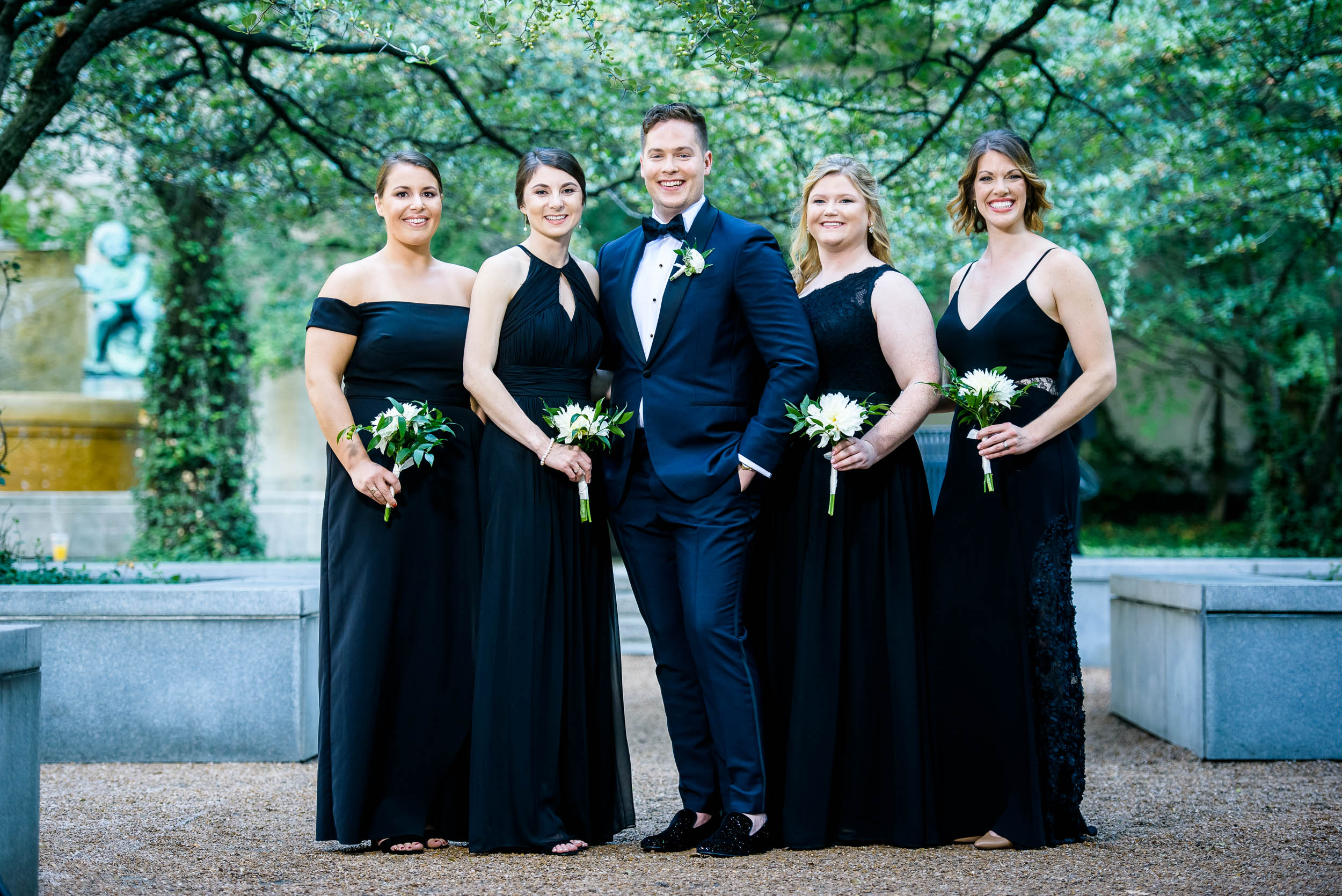 Groom posing with wedding party for luxurious fall wedding at the Chicago Symphony Center captured by J. Brown Photography. See more wedding ideas at jbrownphotography.com!
