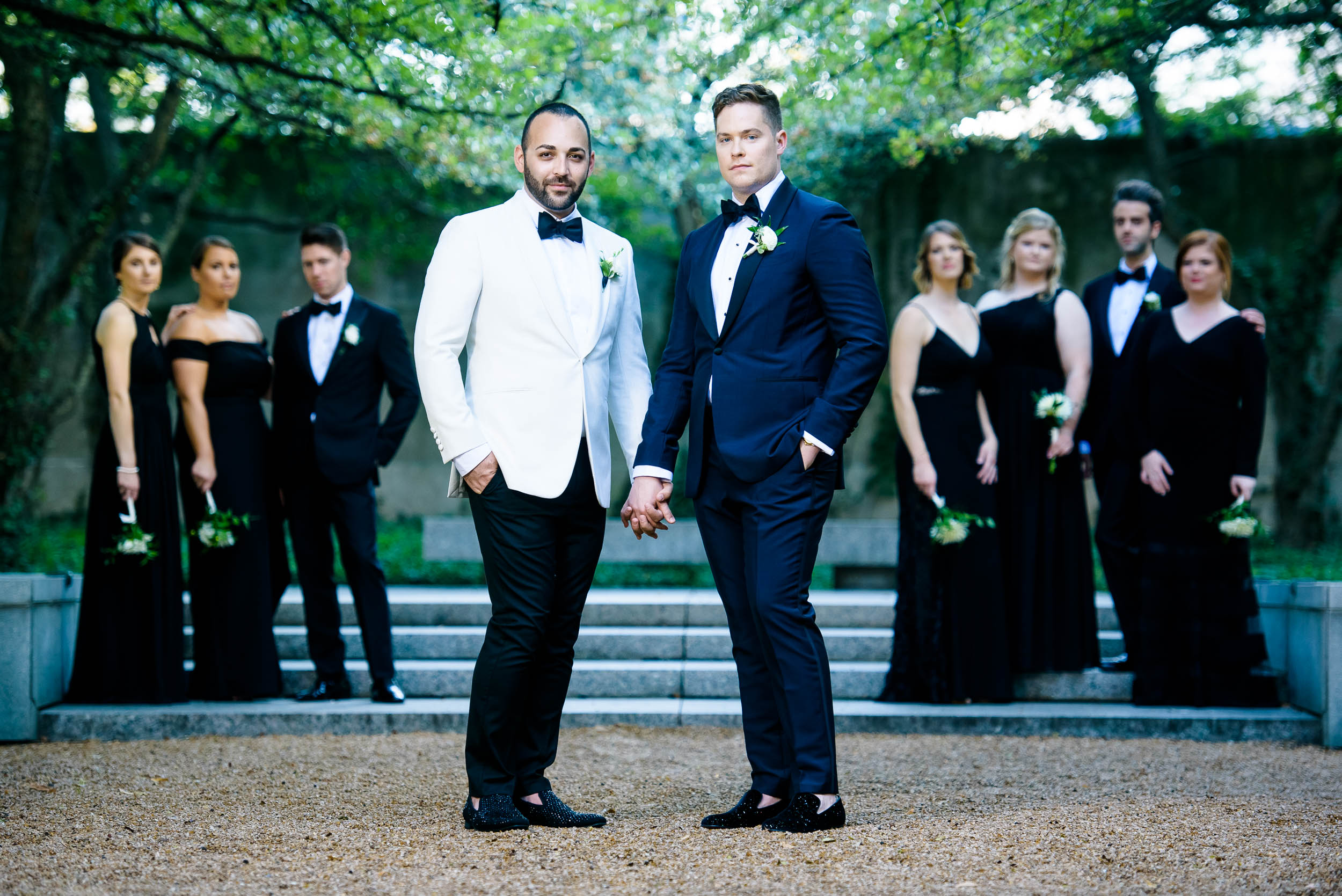 Grooms posing with wedding party for luxurious fall wedding at the Chicago Symphony Center captured by J. Brown Photography. See more wedding ideas at jbrownphotography.com!