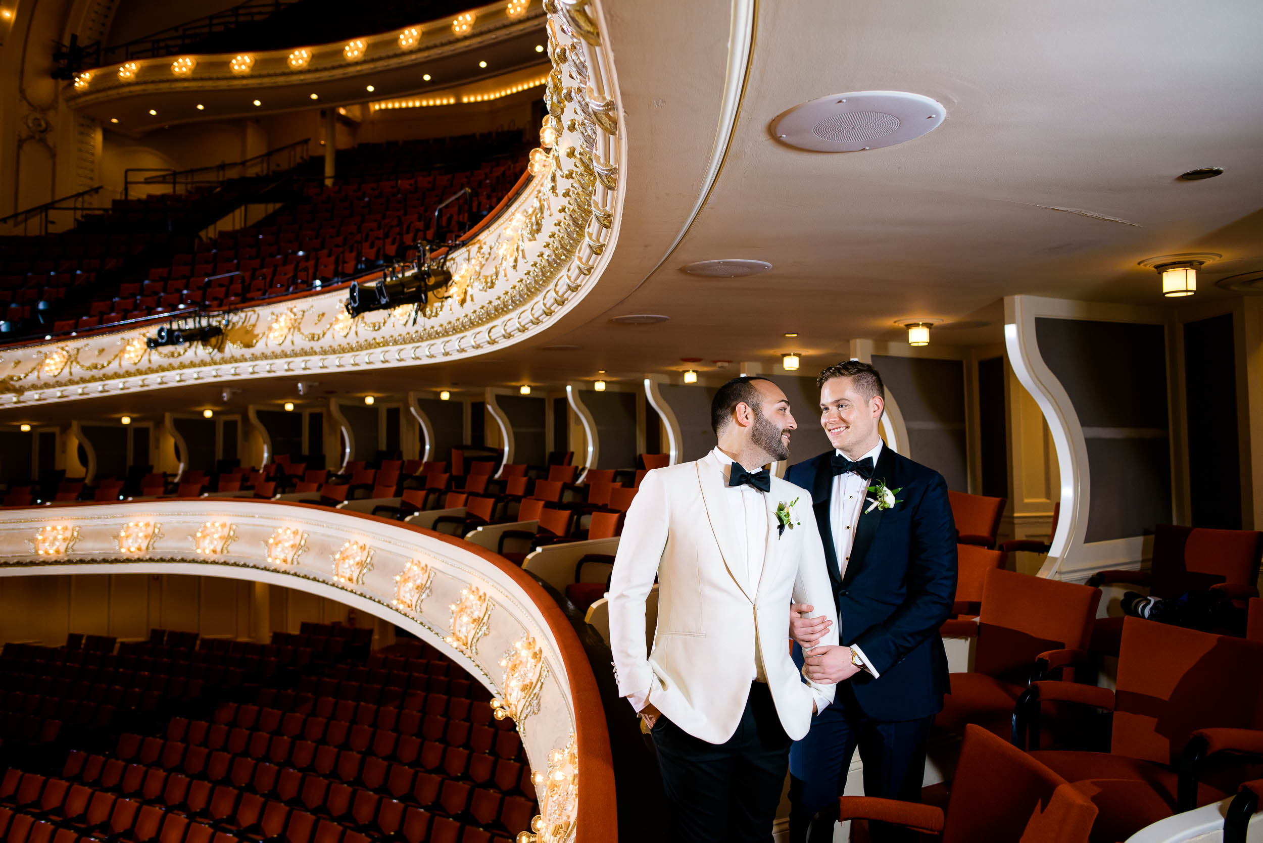 Grooms posing inside wedding venue for luxurious fall wedding at the Chicago Symphony Center captured by J. Brown Photography. See more wedding ideas at jbrownphotography.com!