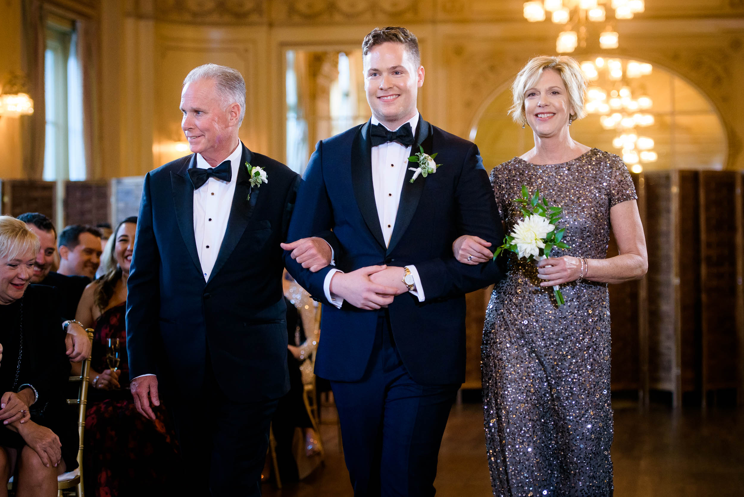 Groom walking down the aisle for luxurious fall wedding at the Chicago Symphony Center captured by J. Brown Photography. See more wedding ideas at jbrownphotography.com!