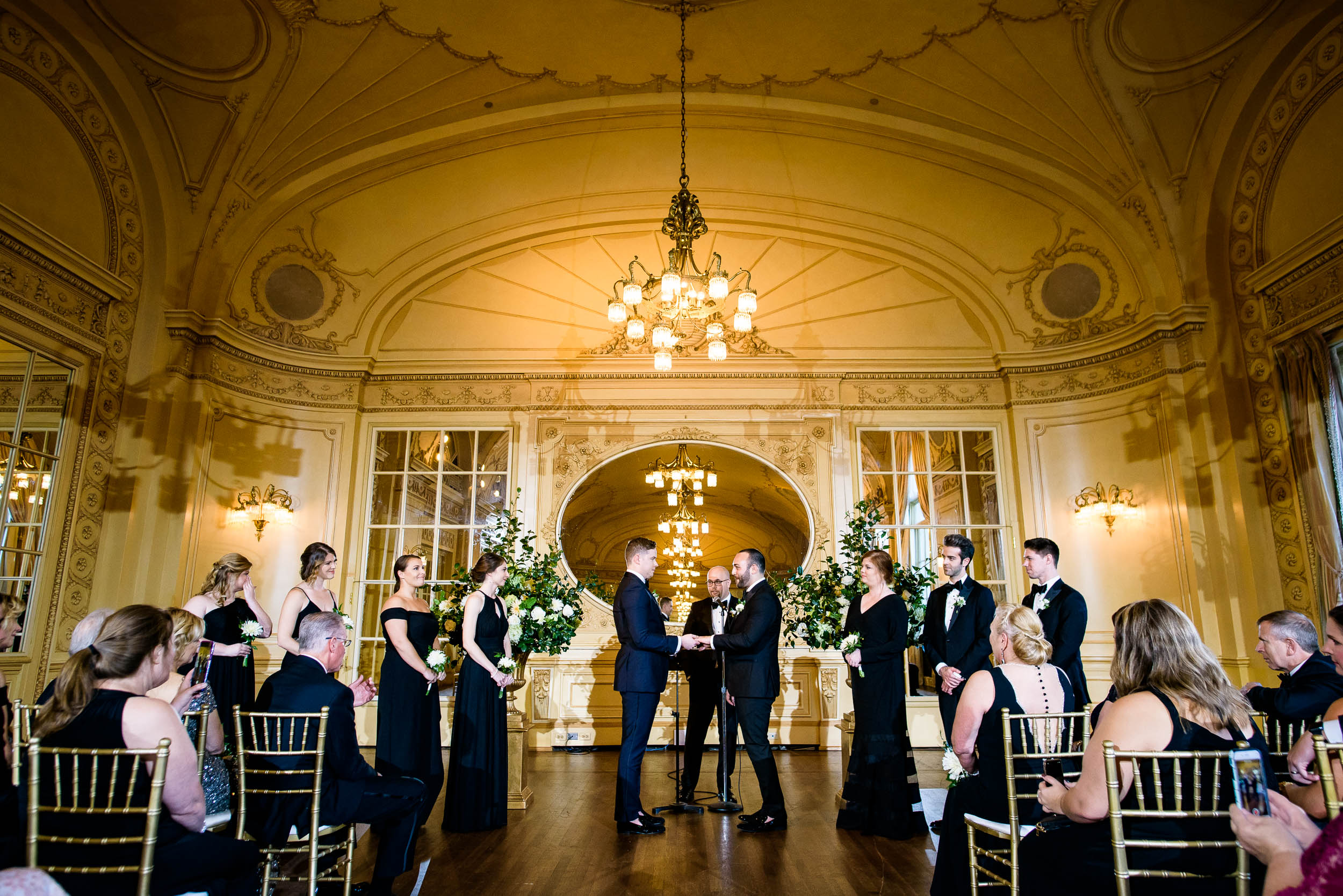Grooms exchange their vows for luxurious fall wedding at the Chicago Symphony Center captured by J. Brown Photography. See more wedding ideas at jbrownphotography.com!
