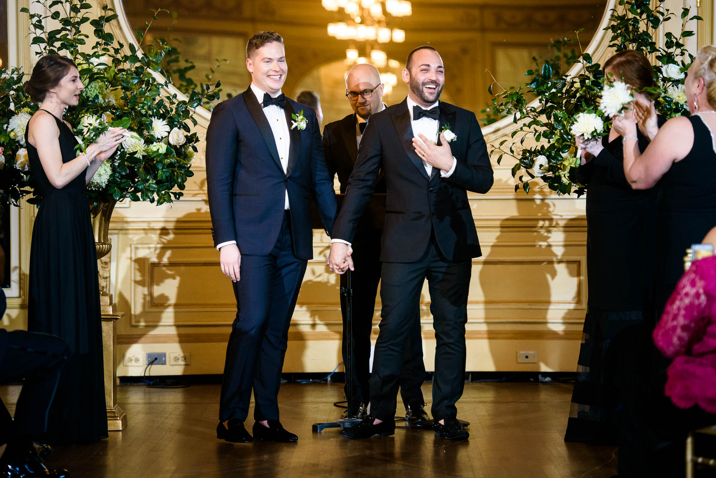 Same-sex wedding ceremony for luxurious fall wedding at the Chicago Symphony Center captured by J. Brown Photography. See more wedding ideas at jbrownphotography.com!
