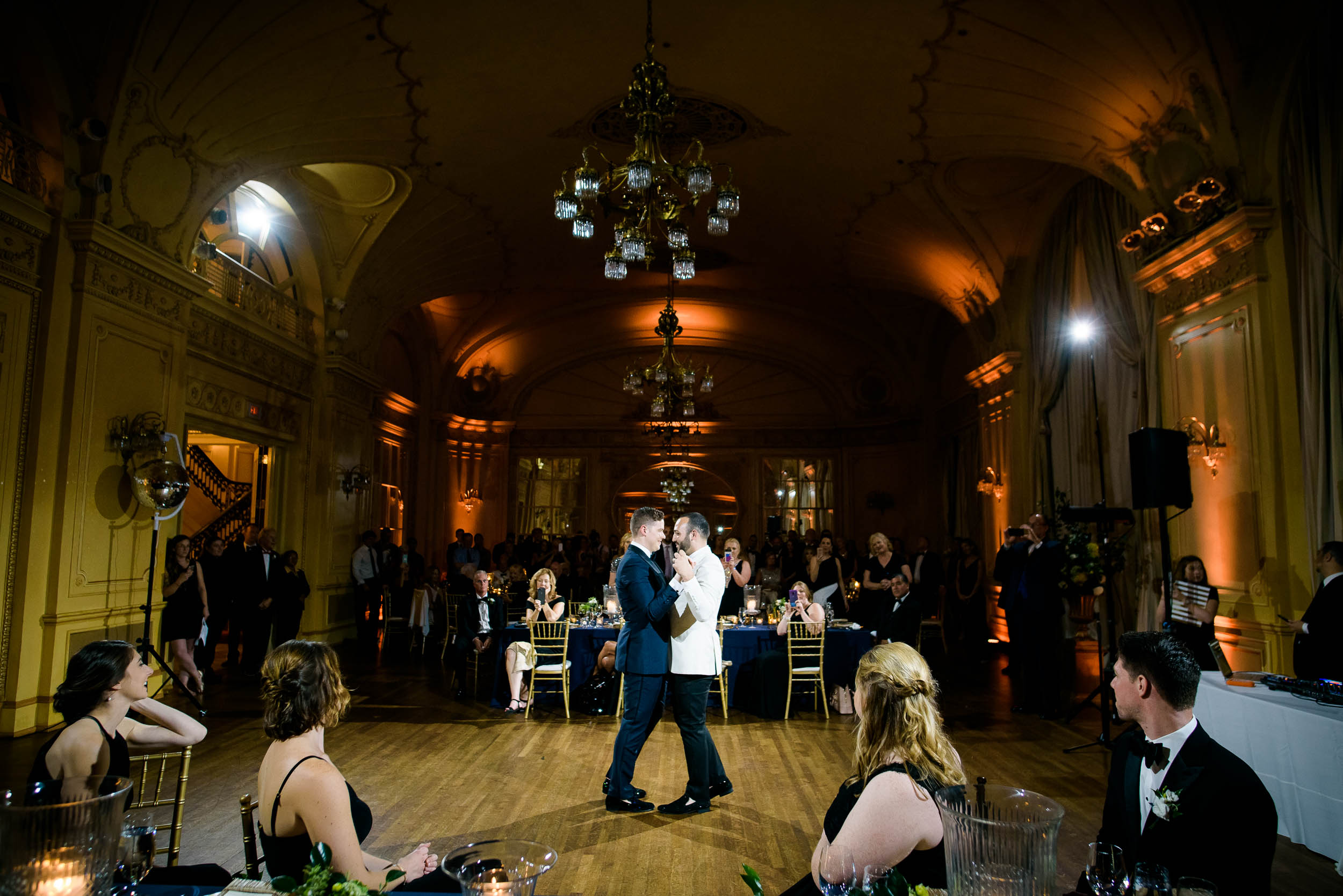Grooms during first dance for luxurious fall wedding at the Chicago Symphony Center captured by J. Brown Photography. See more wedding ideas at jbrownphotography.com!