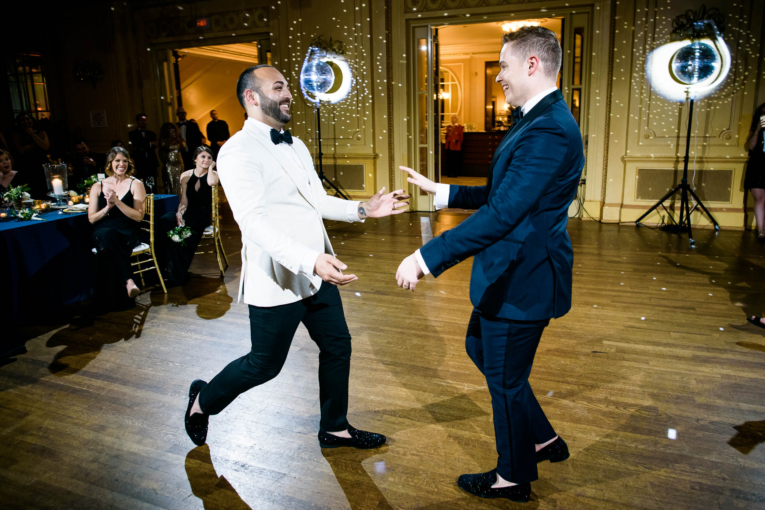 Grooms dancing at wedding reception for luxurious fall wedding at the Chicago Symphony Center captured by J. Brown Photography. See more wedding ideas at jbrownphotography.com!
