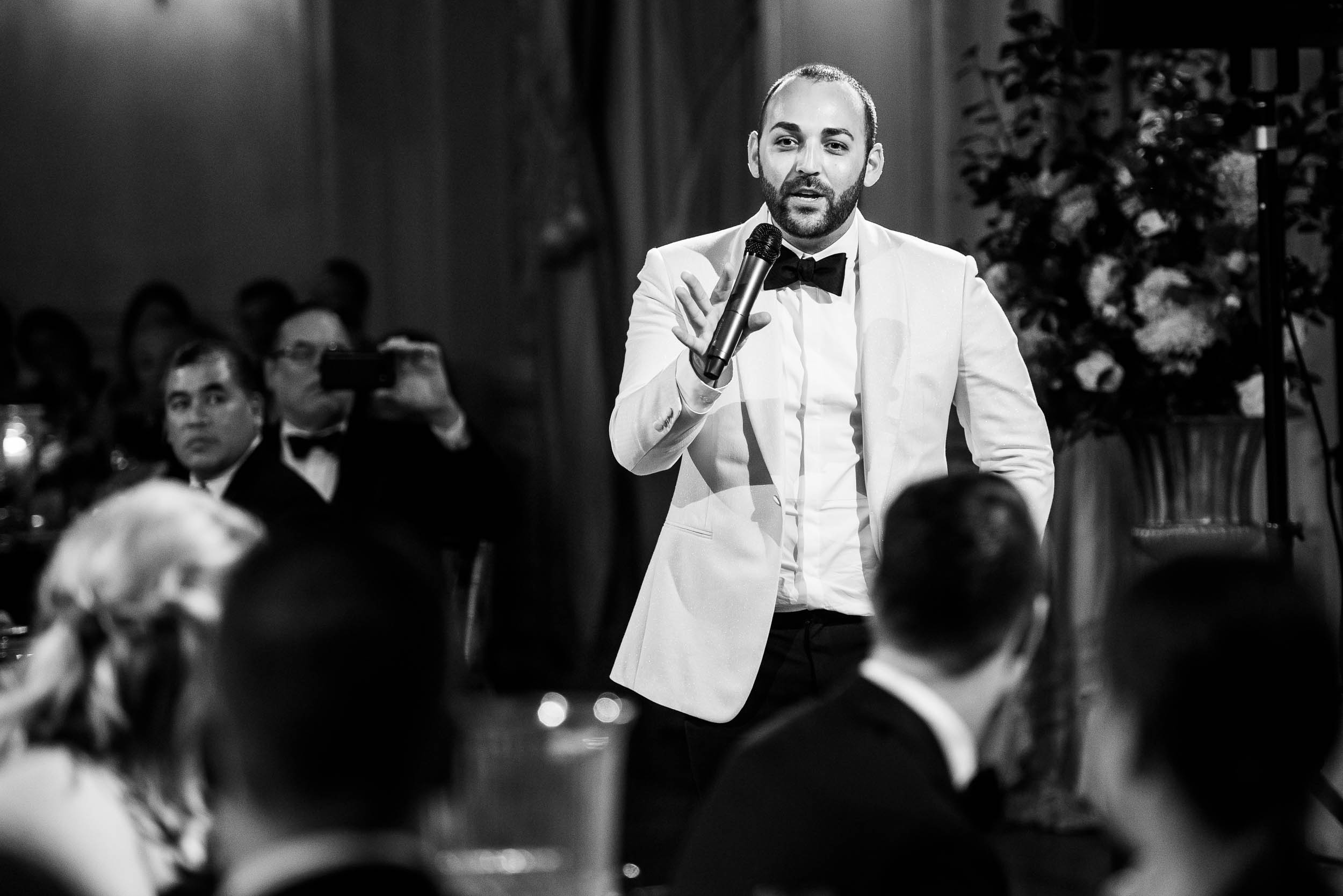 Groom during wedding reception for luxurious fall wedding at the Chicago Symphony Center captured by J. Brown Photography. See more wedding ideas at jbrownphotography.com!