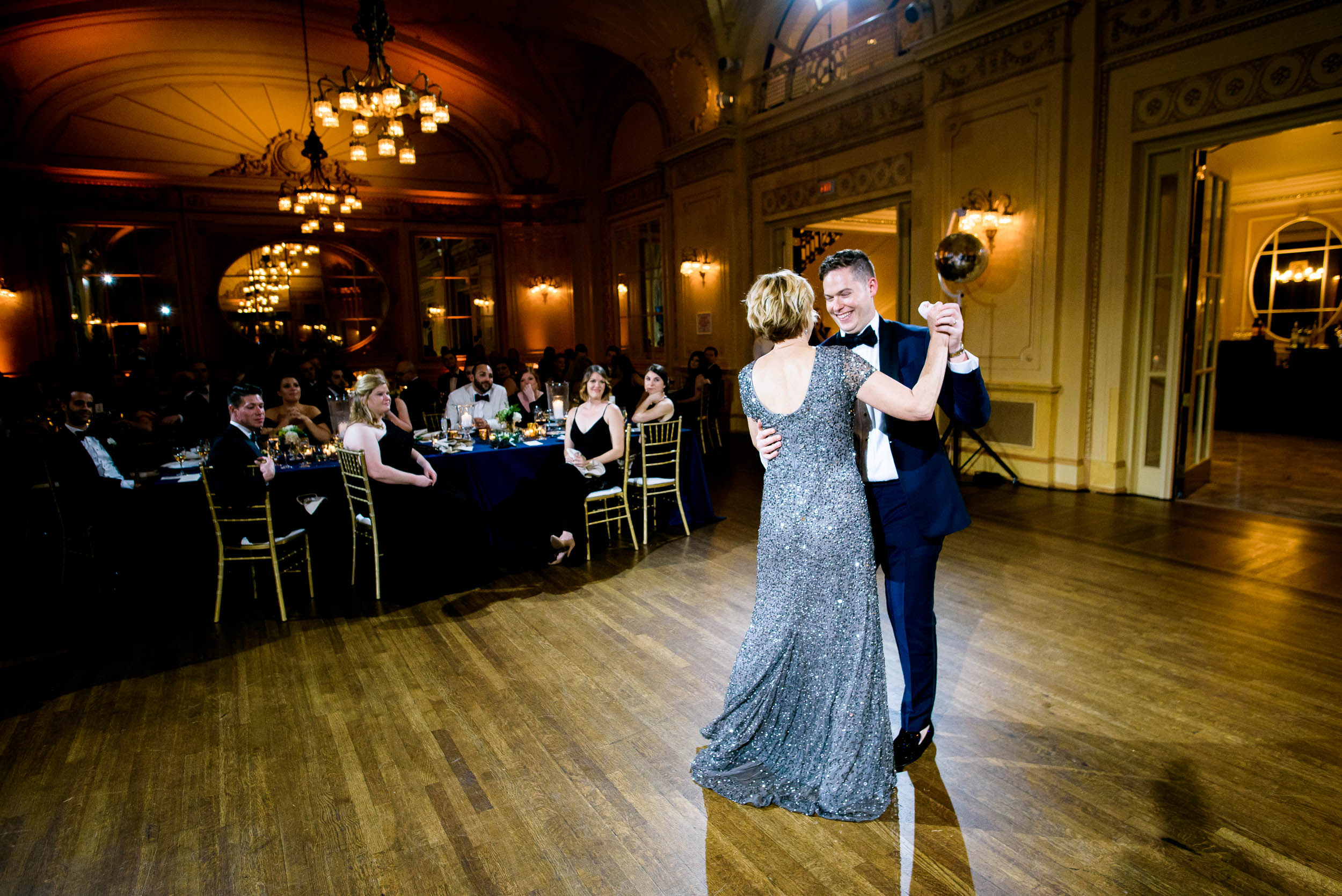 Mother and son dancing at luxurious fall wedding at the Chicago Symphony Center captured by J. Brown Photography. See more wedding ideas at jbrownphotography.com!