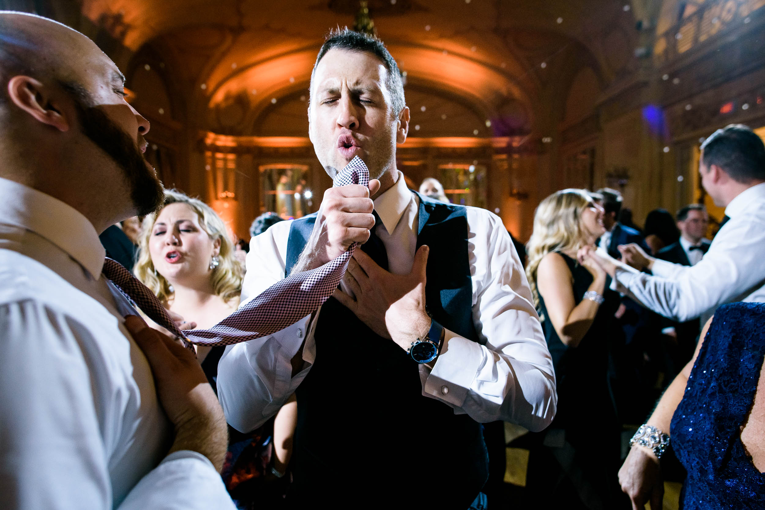 Wedding reception fun at luxurious fall wedding at the Chicago Symphony Center captured by J. Brown Photography. See more wedding ideas at jbrownphotography.com!