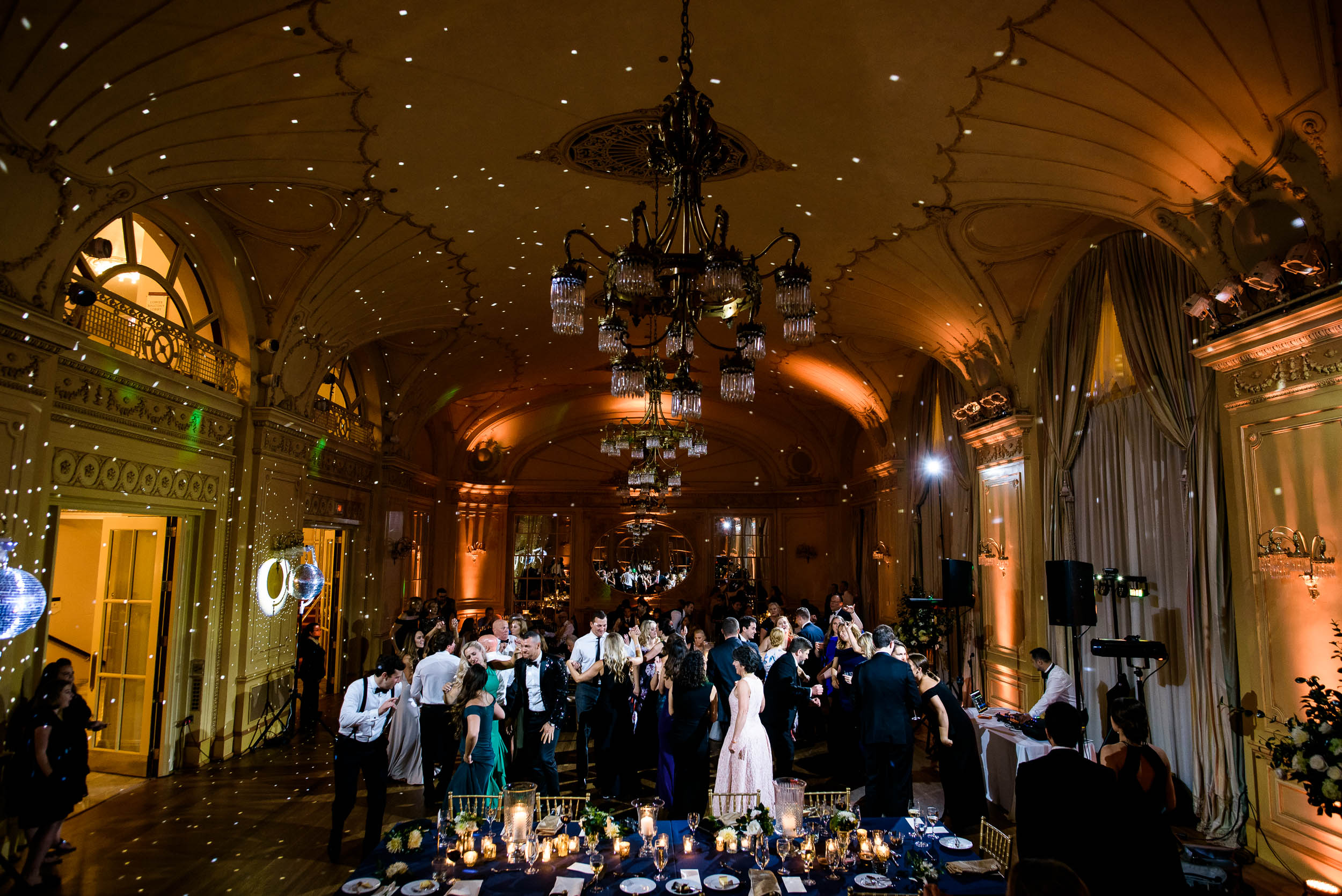 Guests dancing at wedding reception for luxurious fall wedding at the Chicago Symphony Center captured by J. Brown Photography. See more wedding ideas at jbrownphotography.com!