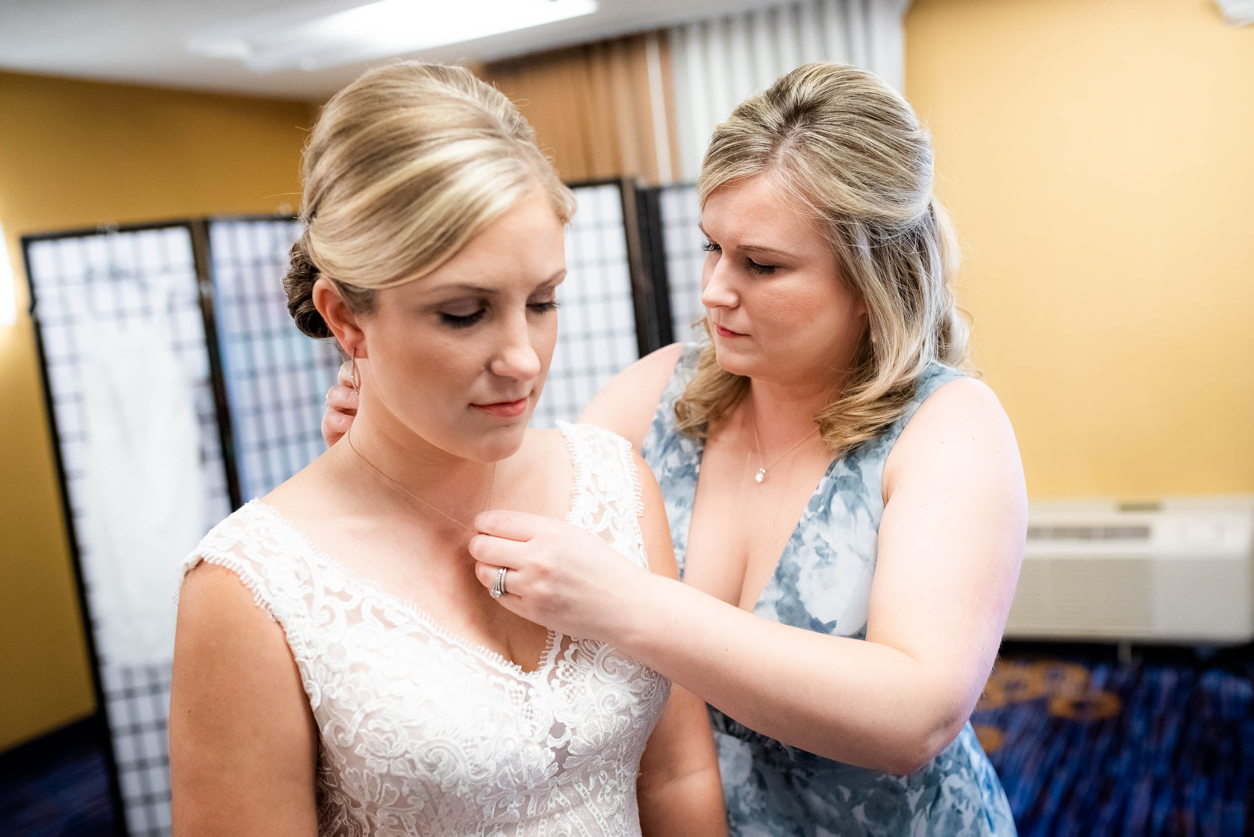 Bride getting ready: Modern industrial Chicago wedding inside Prairie Street Brewhouse captured by J. Brown Photography. Find more wedding ideas at jbrownphotography.com!