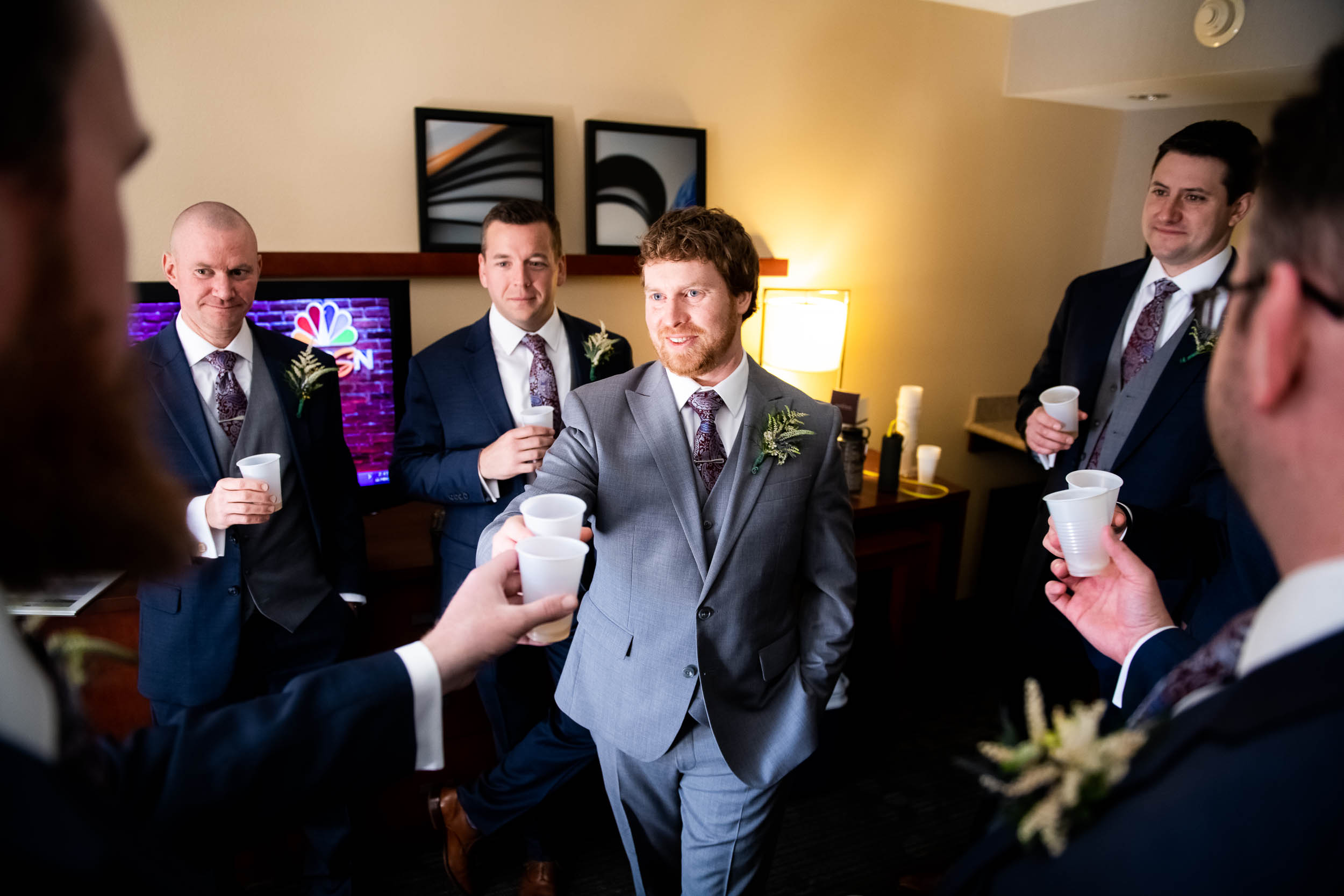 Groomsmen Toast: Modern industrial Chicago wedding inside Prairie Street Brewhouse captured by J. Brown Photography. Find more wedding ideas at jbrownphotography.com!