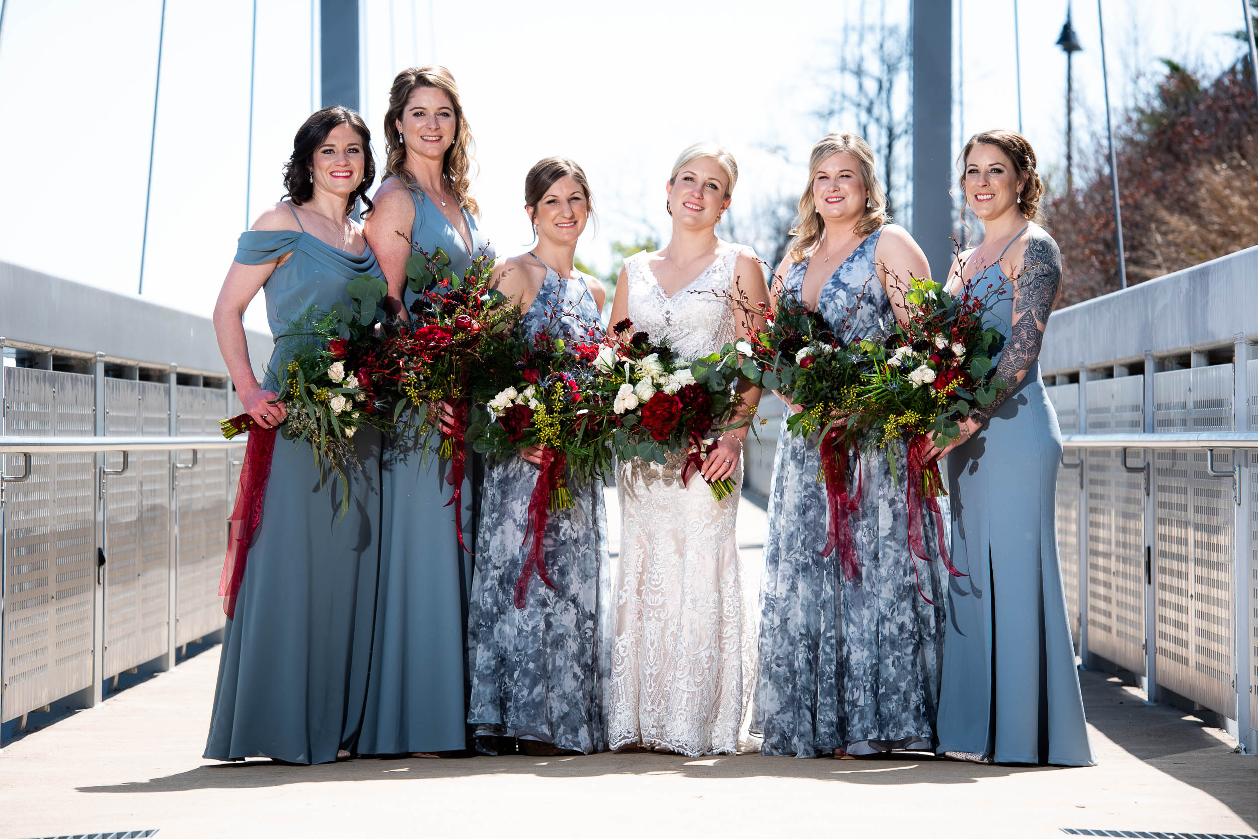 Blue bridesmaids dresses: Modern industrial Chicago wedding inside Prairie Street Brewhouse captured by J. Brown Photography. Find more wedding ideas at jbrownphotography.com!