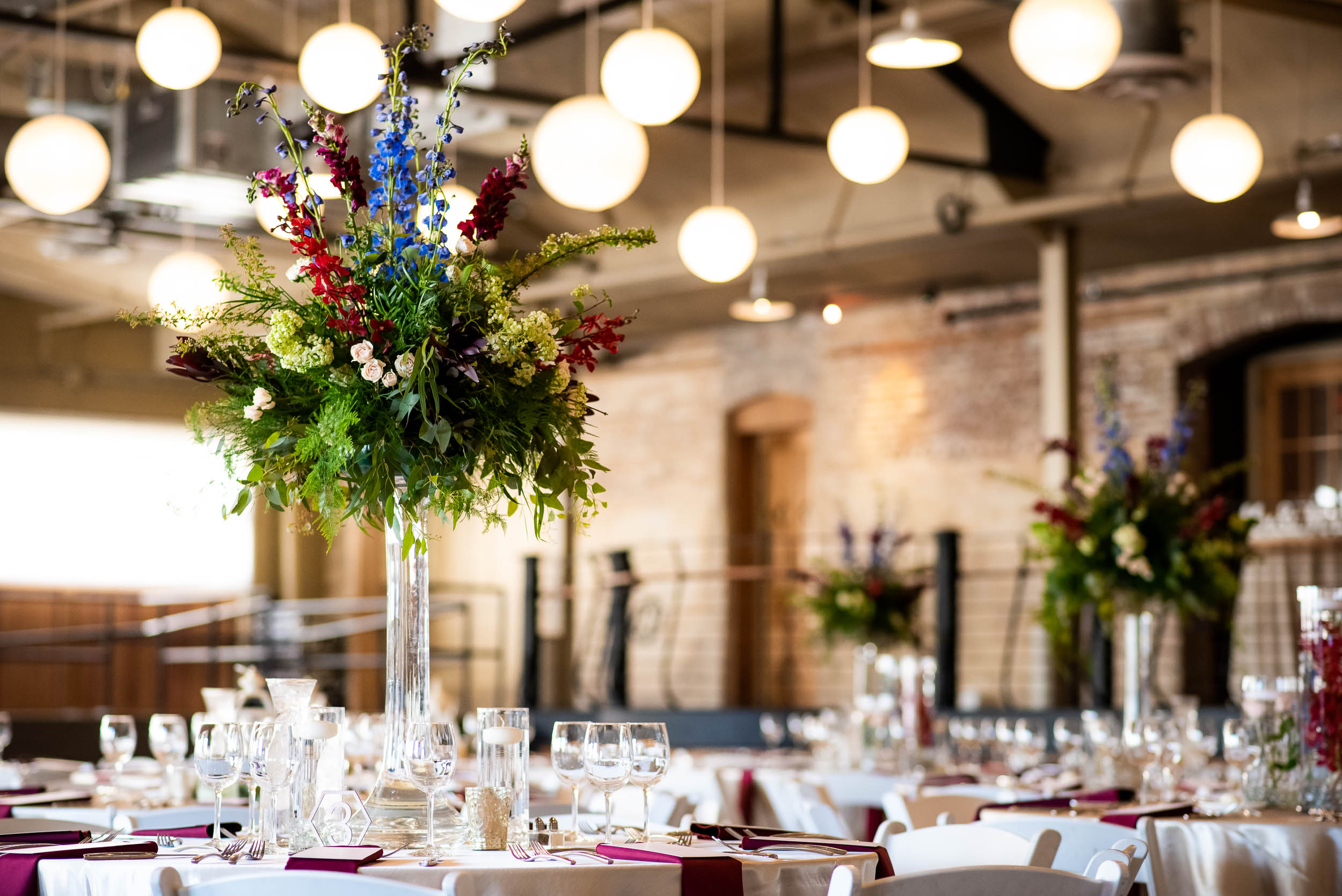 Wedding reception decor: Modern industrial Chicago wedding inside Prairie Street Brewhouse captured by J. Brown Photography. Find more wedding ideas at jbrownphotography.com!