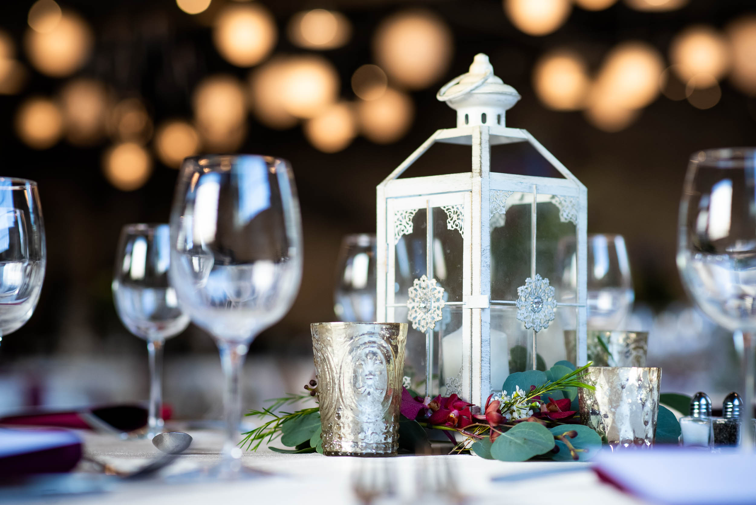 Lantern wedding centerpieces: Modern industrial Chicago wedding inside Prairie Street Brewhouse captured by J. Brown Photography. Find more wedding ideas at jbrownphotography.com!