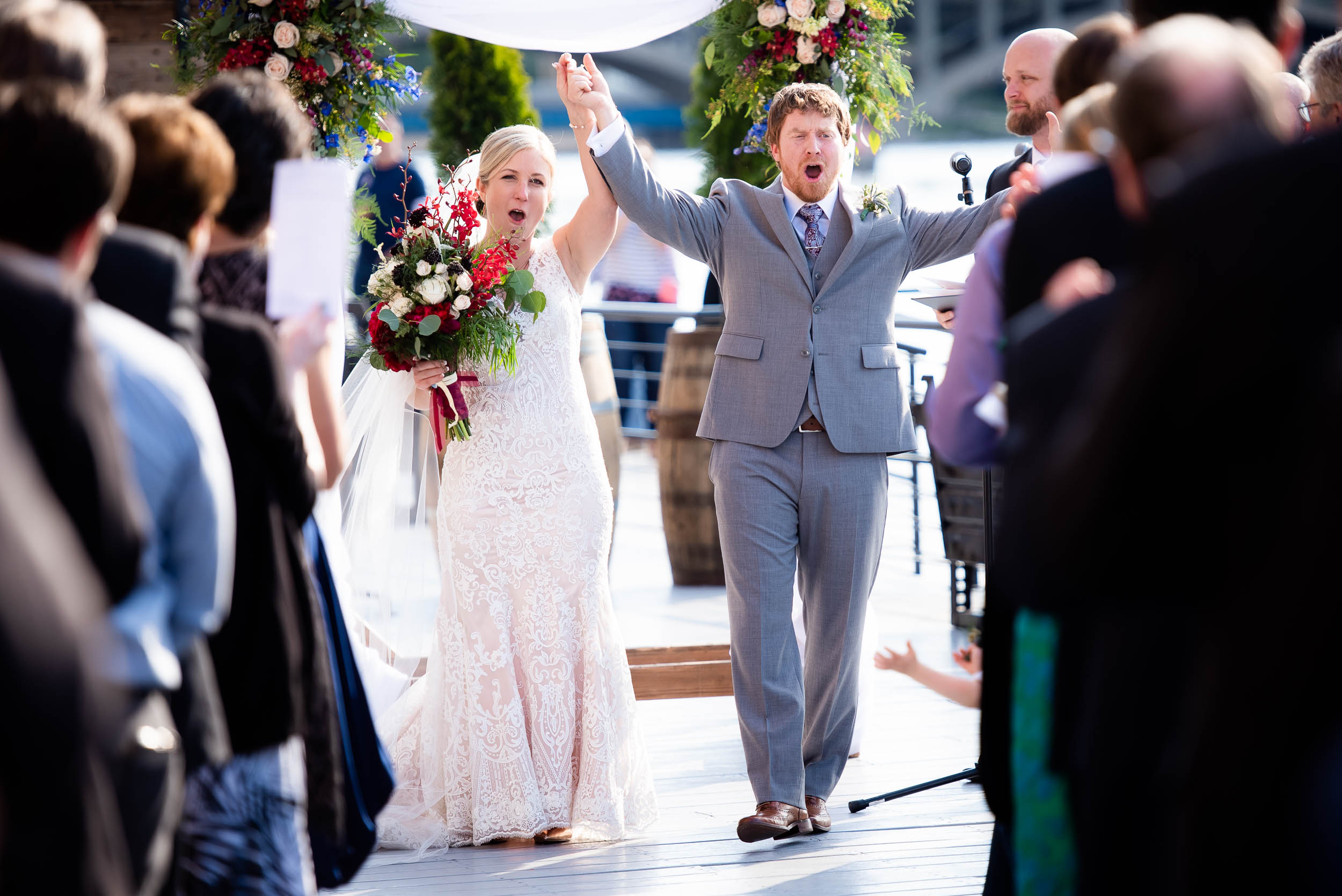 Wedding ceremony exit: Modern industrial Chicago wedding inside Prairie Street Brewhouse captured by J. Brown Photography. Find more wedding ideas at jbrownphotography.com!