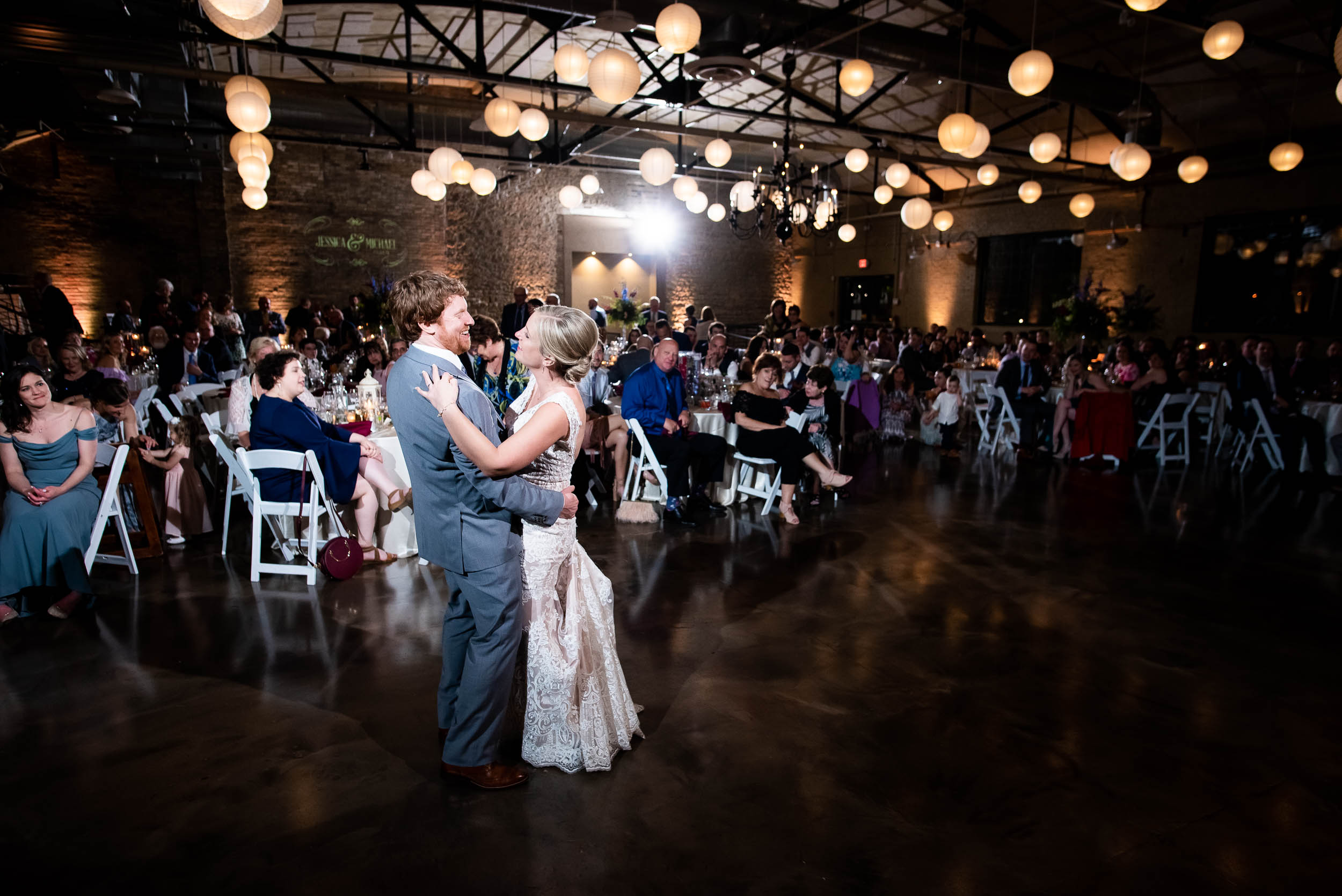 Wedding dancing: Modern industrial Chicago wedding inside Prairie Street Brewhouse captured by J. Brown Photography. Find more wedding ideas at jbrownphotography.com!