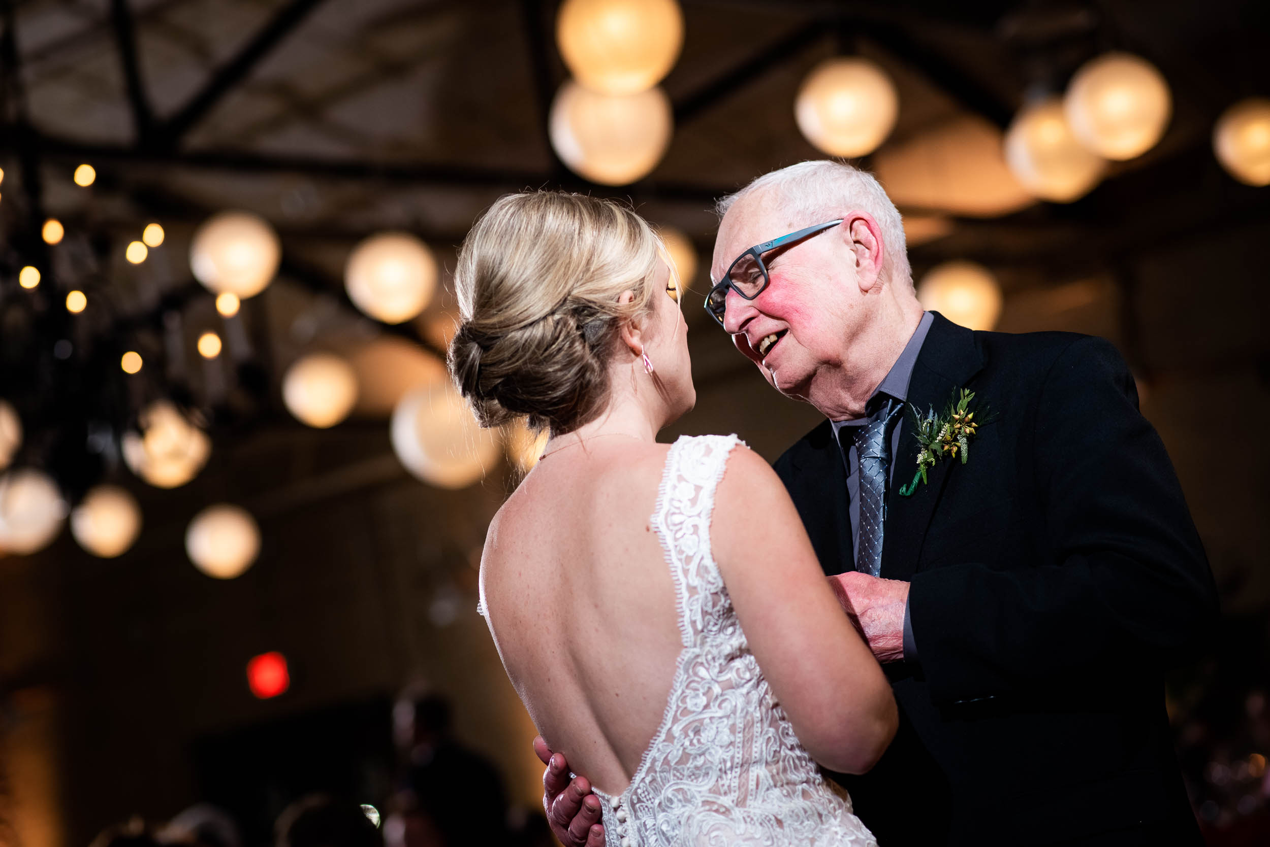 Father/daughter dance: Modern industrial Chicago wedding inside Prairie Street Brewhouse captured by J. Brown Photography. Find more wedding ideas at jbrownphotography.com!