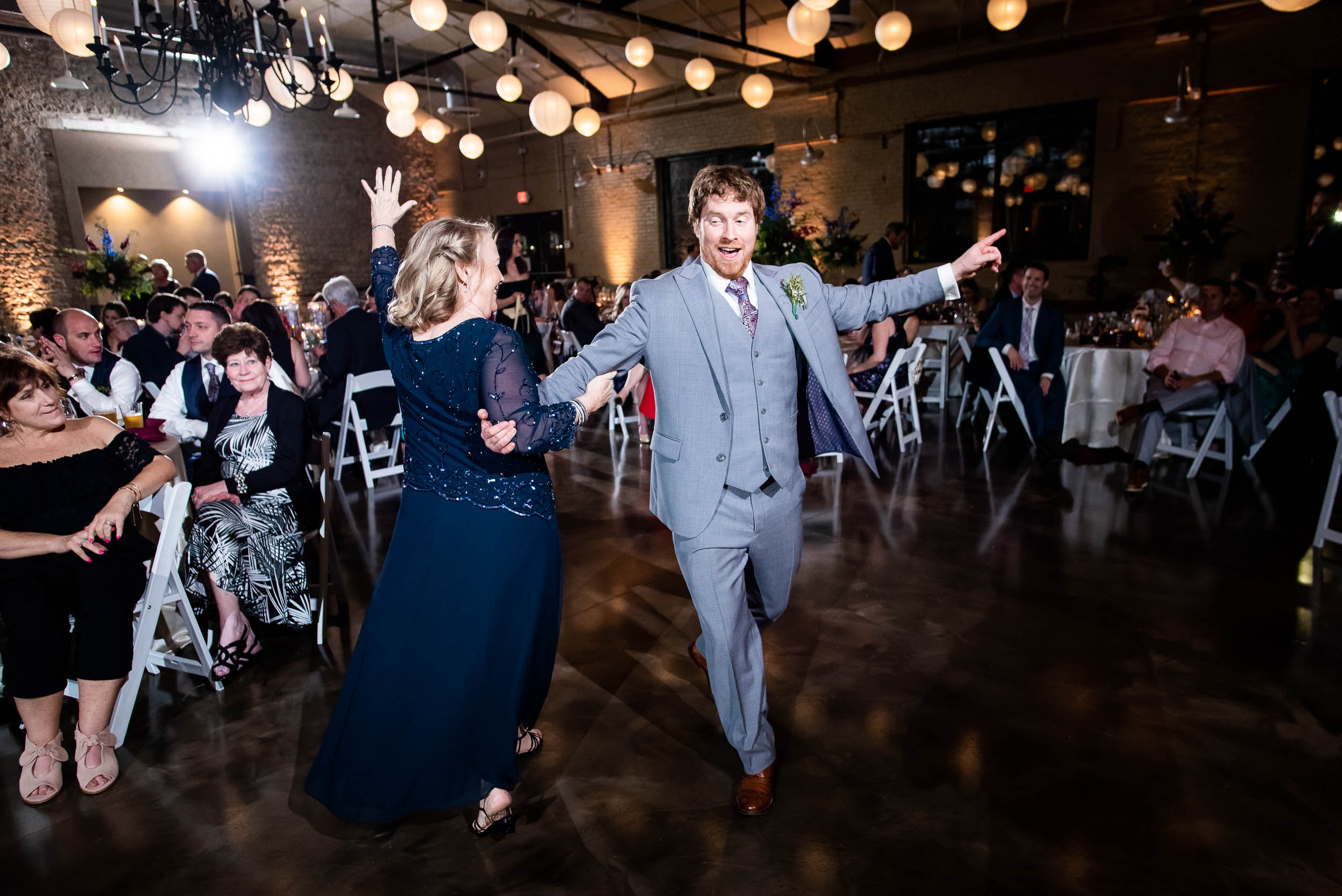 Mother/son dance: Modern industrial Chicago wedding inside Prairie Street Brewhouse captured by J. Brown Photography. Find more wedding ideas at jbrownphotography.com!