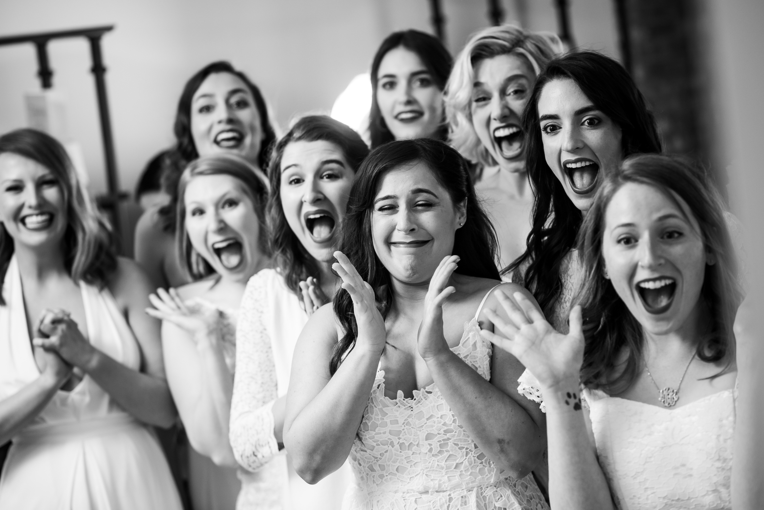 Bridesmaids seeing bride in wedding dress for Carnivale Chicago wedding captured by J Brown Photography