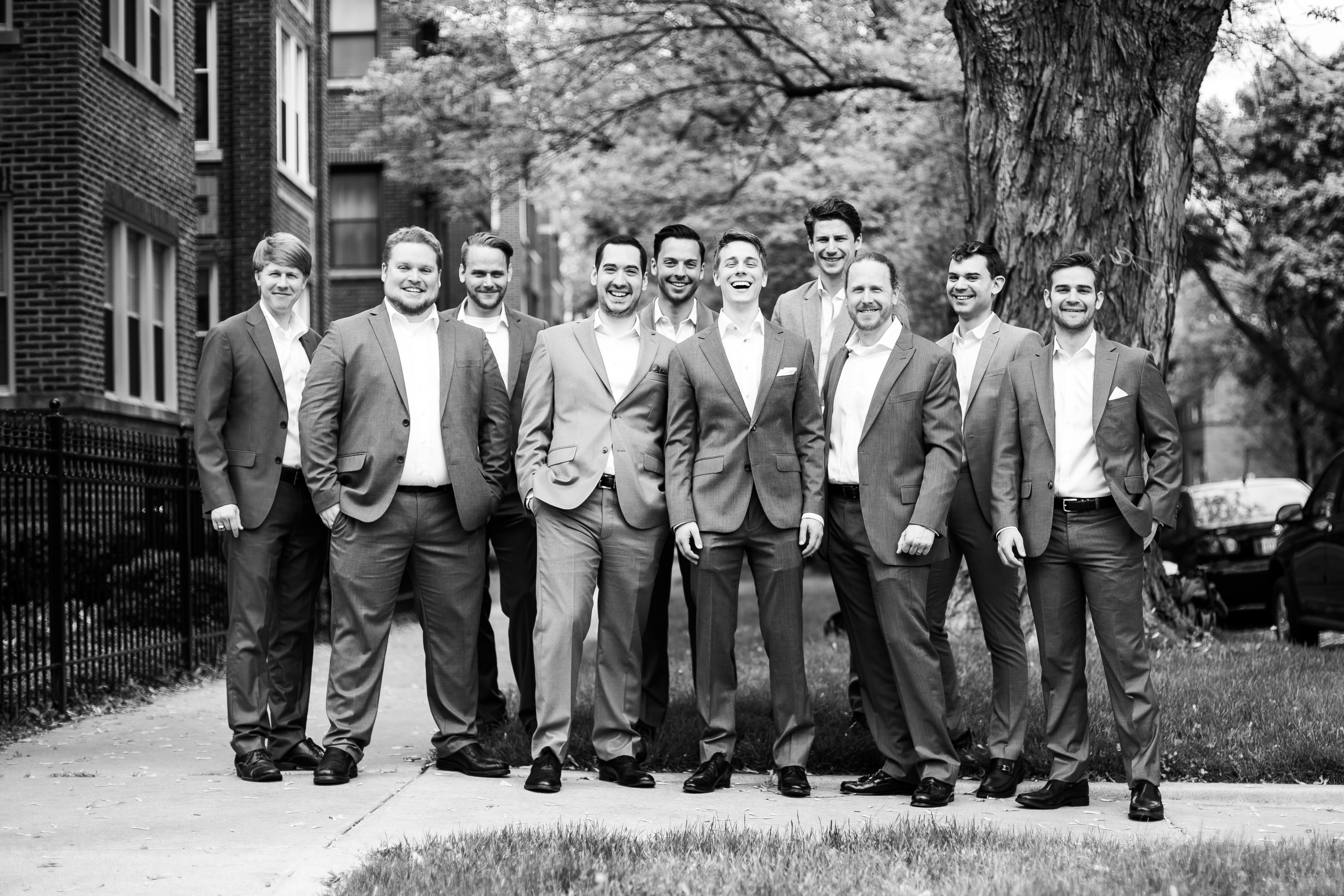 Groom and groomsmen pose for wedding photos for Carnivale Chicago wedding captured by J Brown Photography