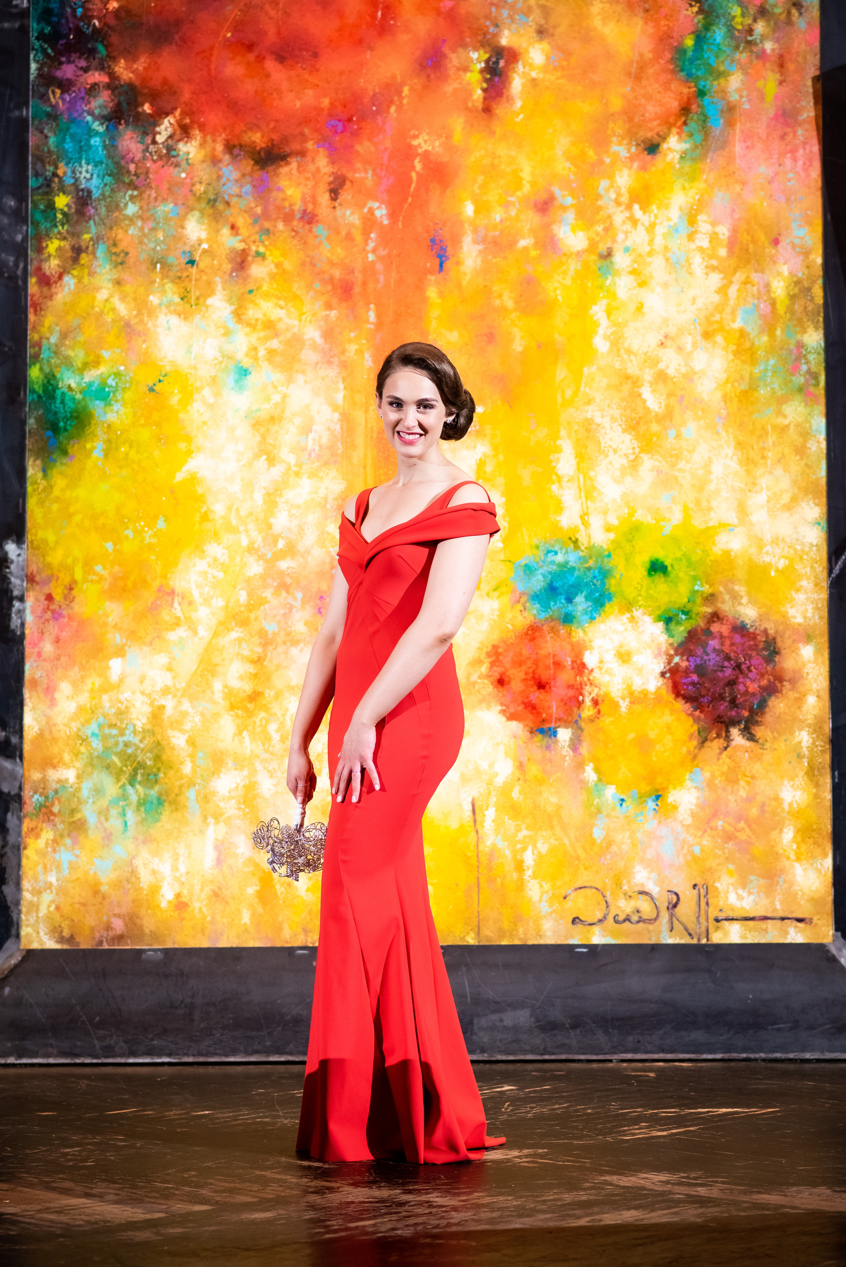 Bridal portrait of bride in red wedding dress for Carnivale Chicago wedding captured by J Brown Photography
