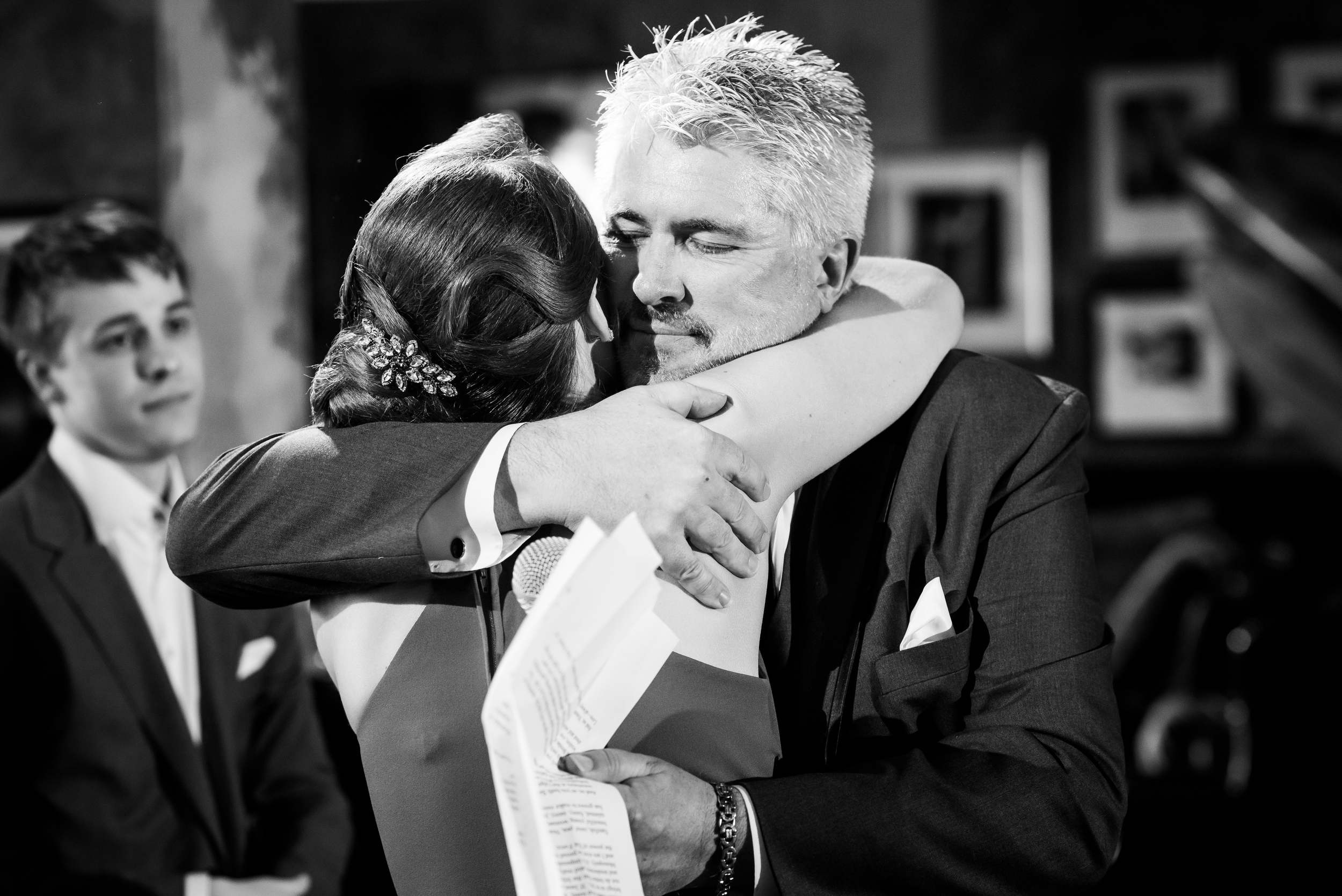 Father of the bride and the bride sharing a hug: Carnivale Chicago wedding captured by J Brown Photography