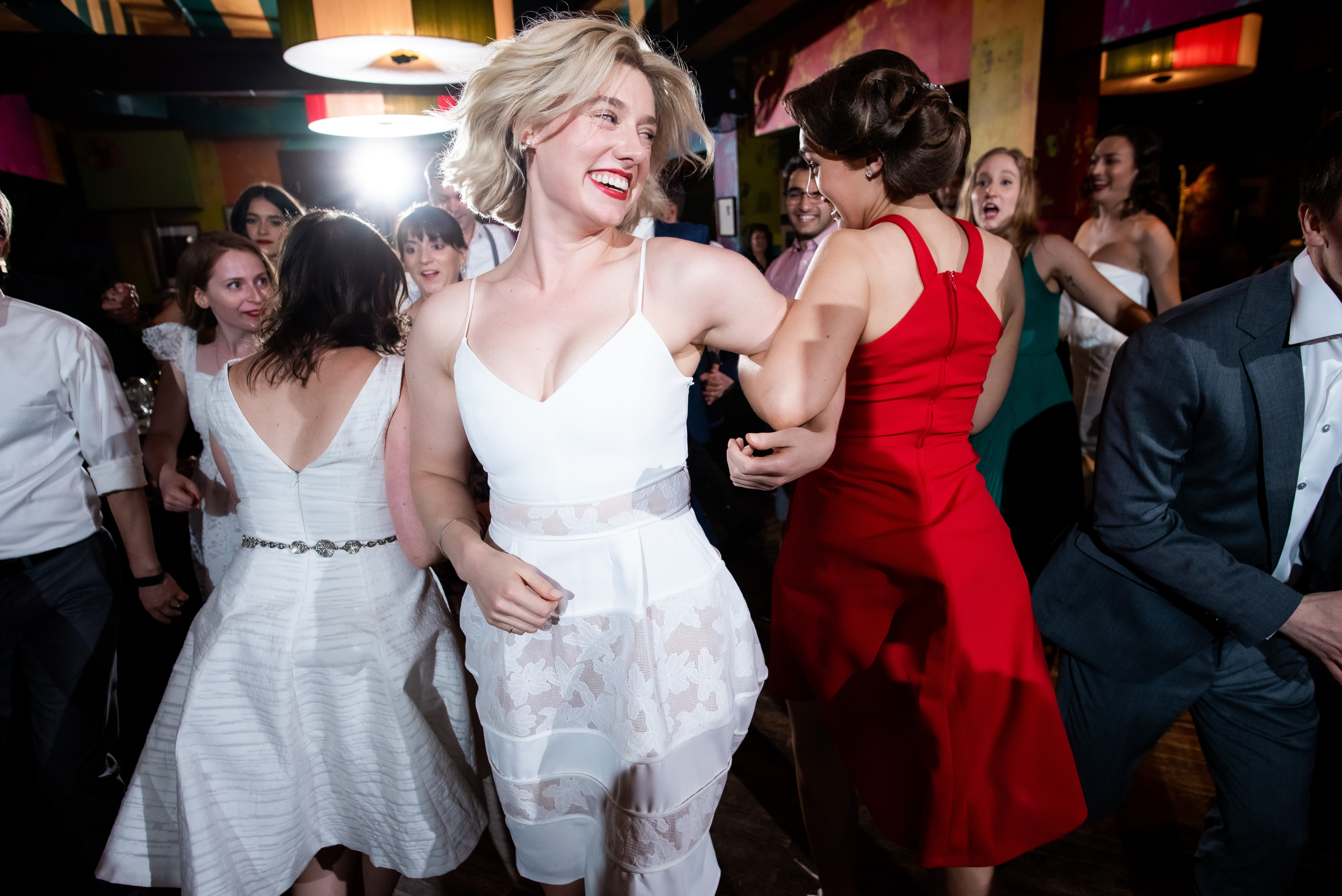 Wedding guests dancing during Carnivale Chicago wedding captured by J Brown Photography
