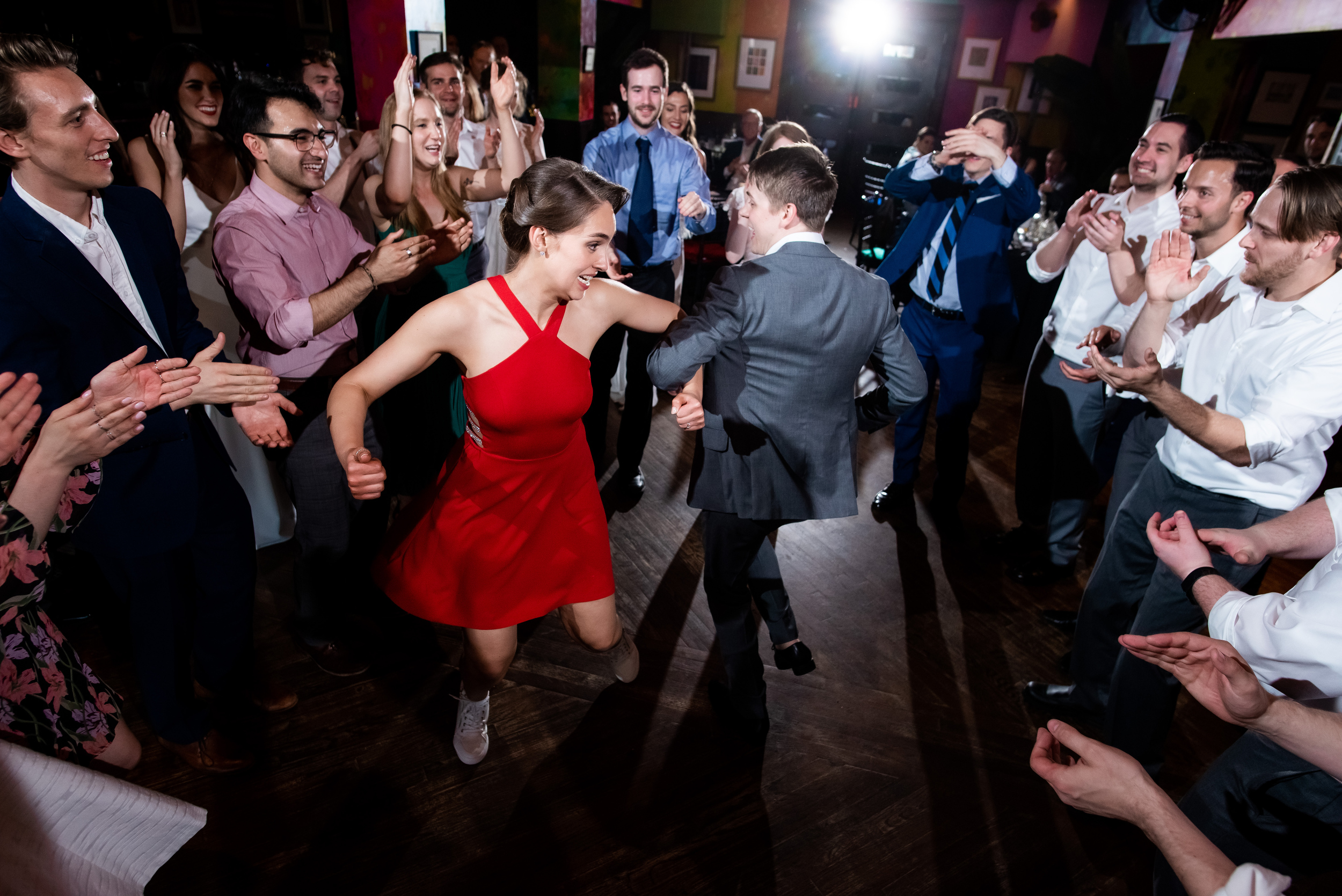 Bride and groom dancing during Carnivale Chicago wedding captured by J Brown Photography