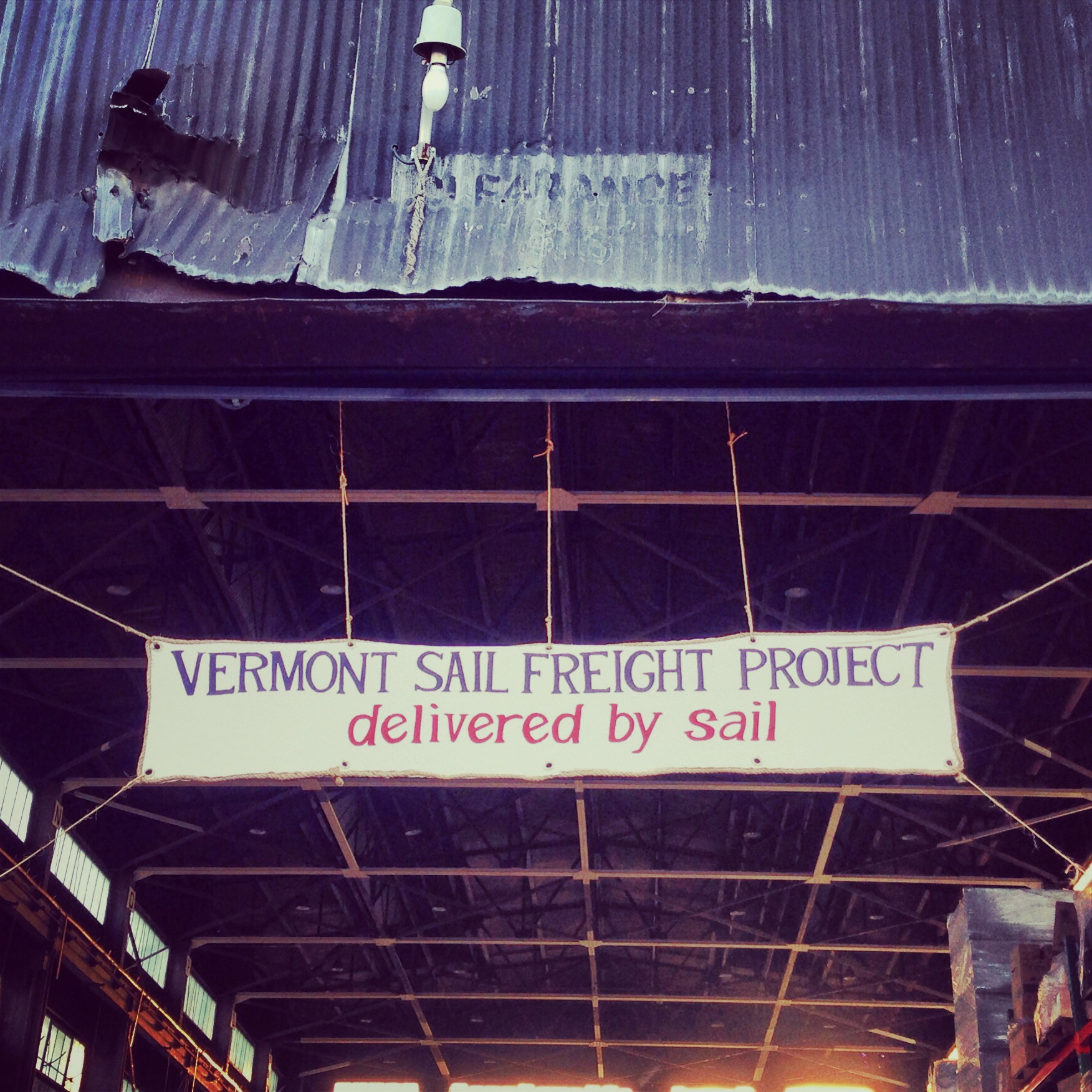 Banner over a warehouse in the Navy Yard announcing the first Vermont Sail Freight Project market in Brooklyn.