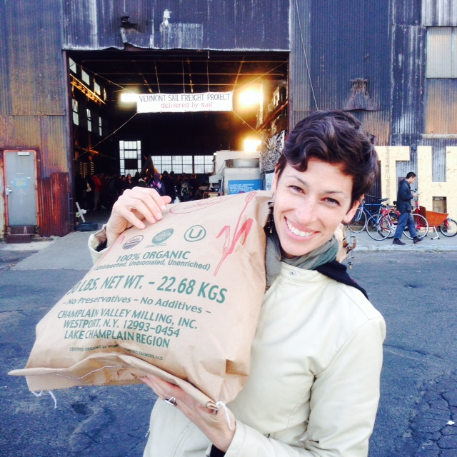 A very happy baker, taking home some of her favorite organic bread flour from Mt. Marcy.