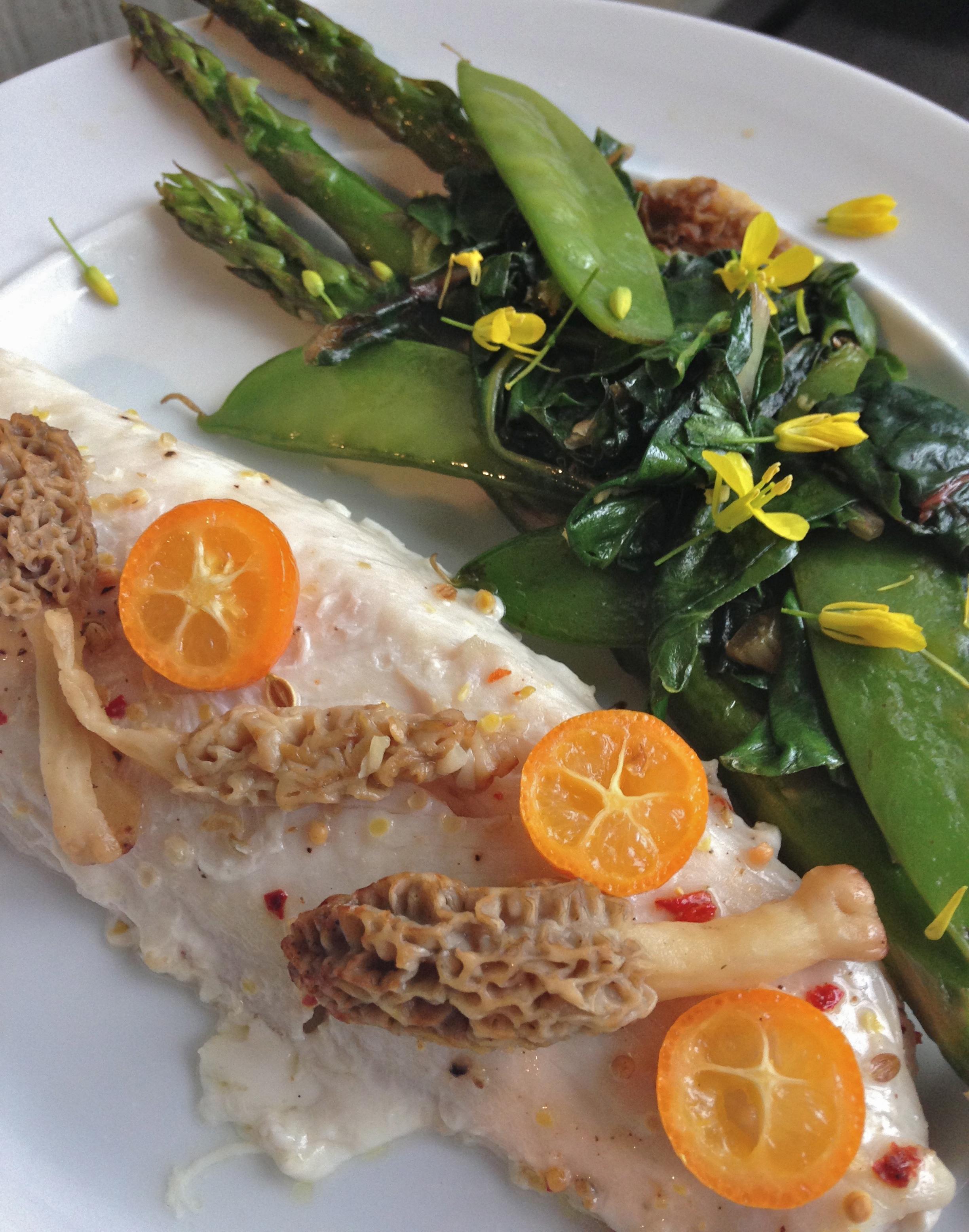 Broiled mahi mahi with morels, asparagus, peas, chard, and edible wild mustard flowers.