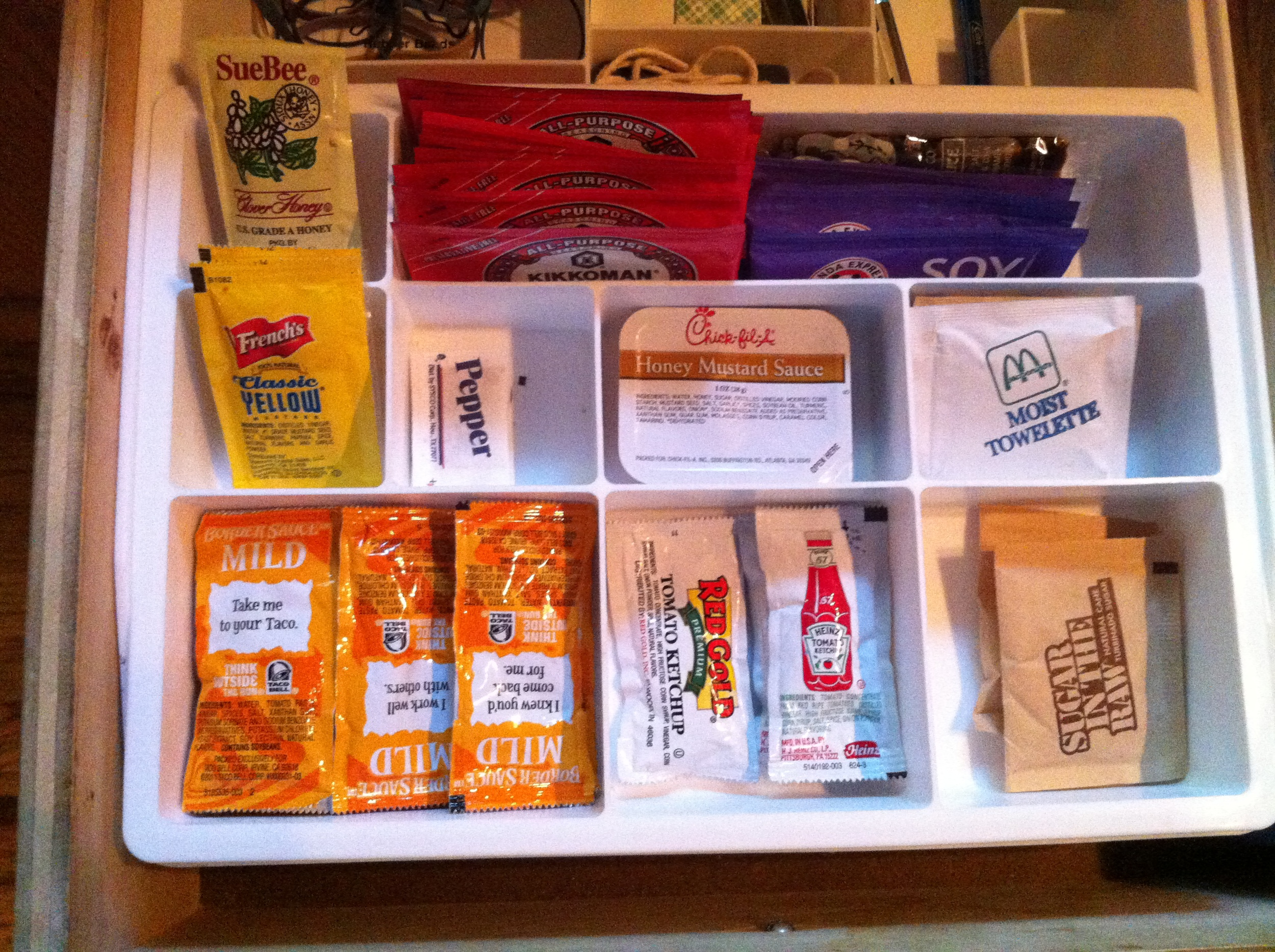 Finished junk drawer - here's top compartment, where I keep all of my little condiments.  If they get full, it's time to throw out!