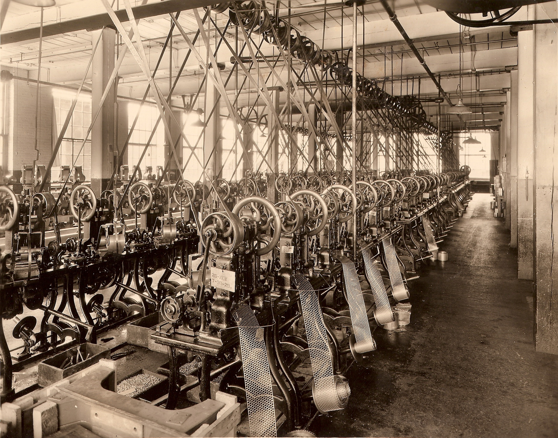 Early version Cap machines at the Front Street Plant of J.C. Rhodes.