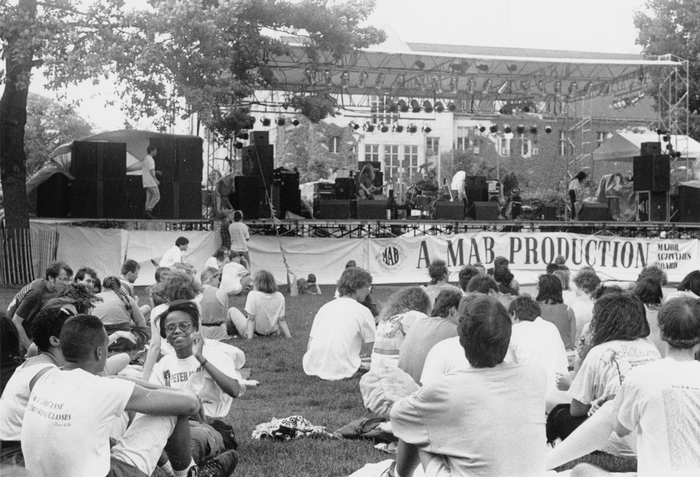 University of Chicago students enjoy the music by the band 13 Nightmares. The concert on the quad was sponsored by the Major Activities Board.  VII: Chicago Maroon