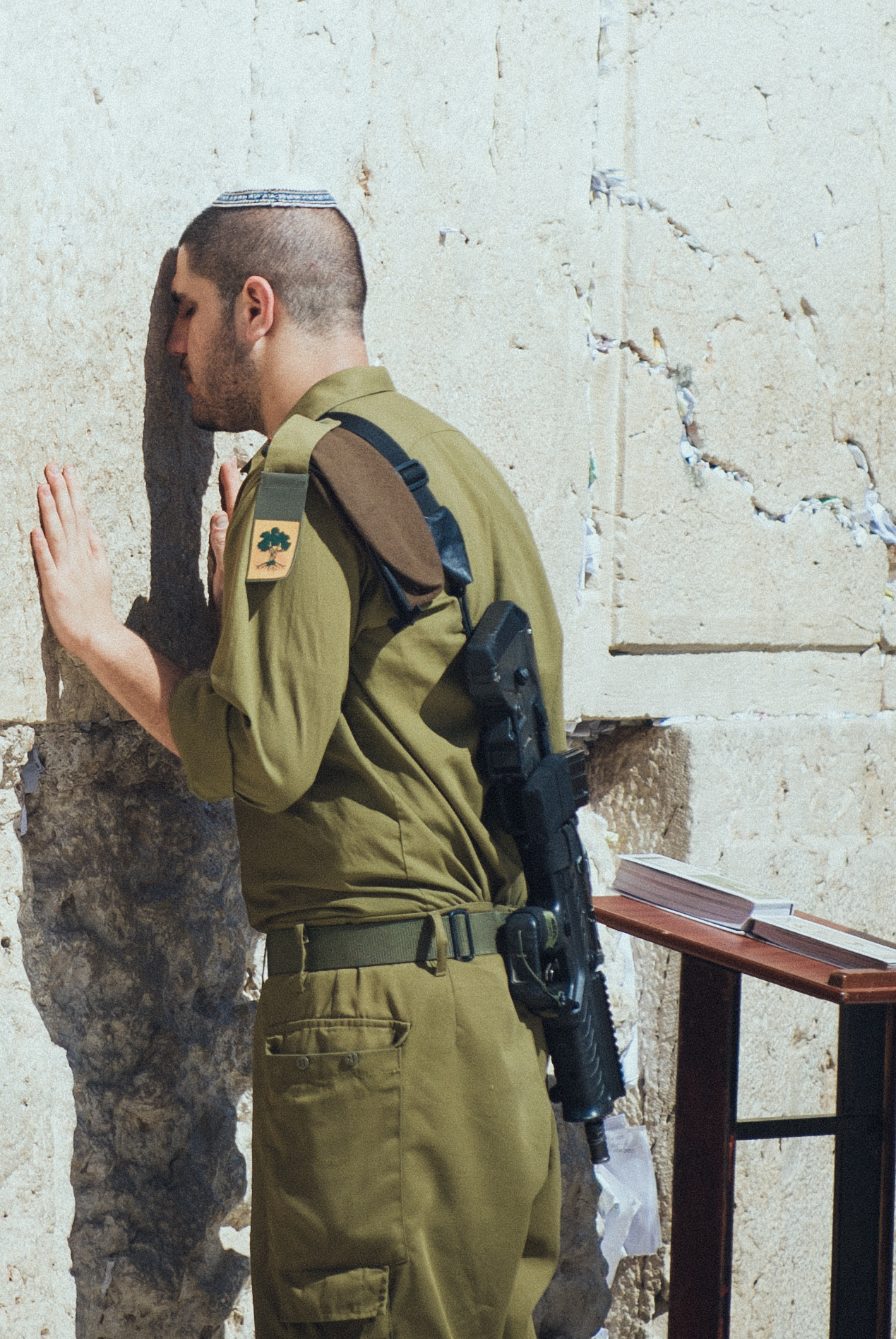 Young Israeli soldier meditating the Torah & praying at the Wall in Jerusalem