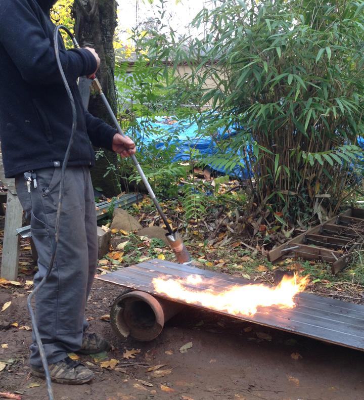 Portland Small Family House - burning charring cedar propane