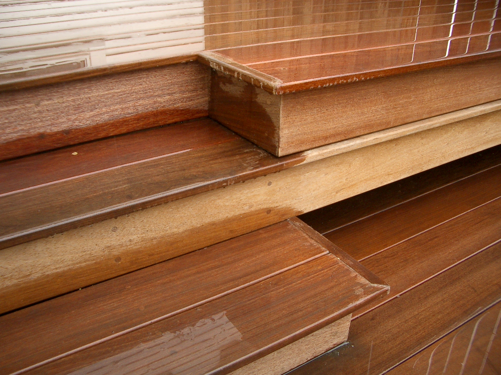 This is a deck made of IPE hardwood and the transition detail between the stairs and a larger step/seat.