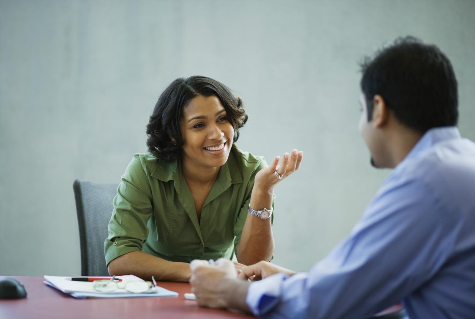 WOMAN-TALKING-OFFICE.jpg