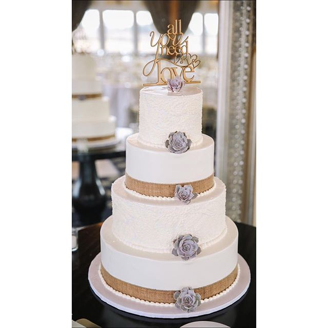 White Wedding Cake and Silver Flowers.jpg