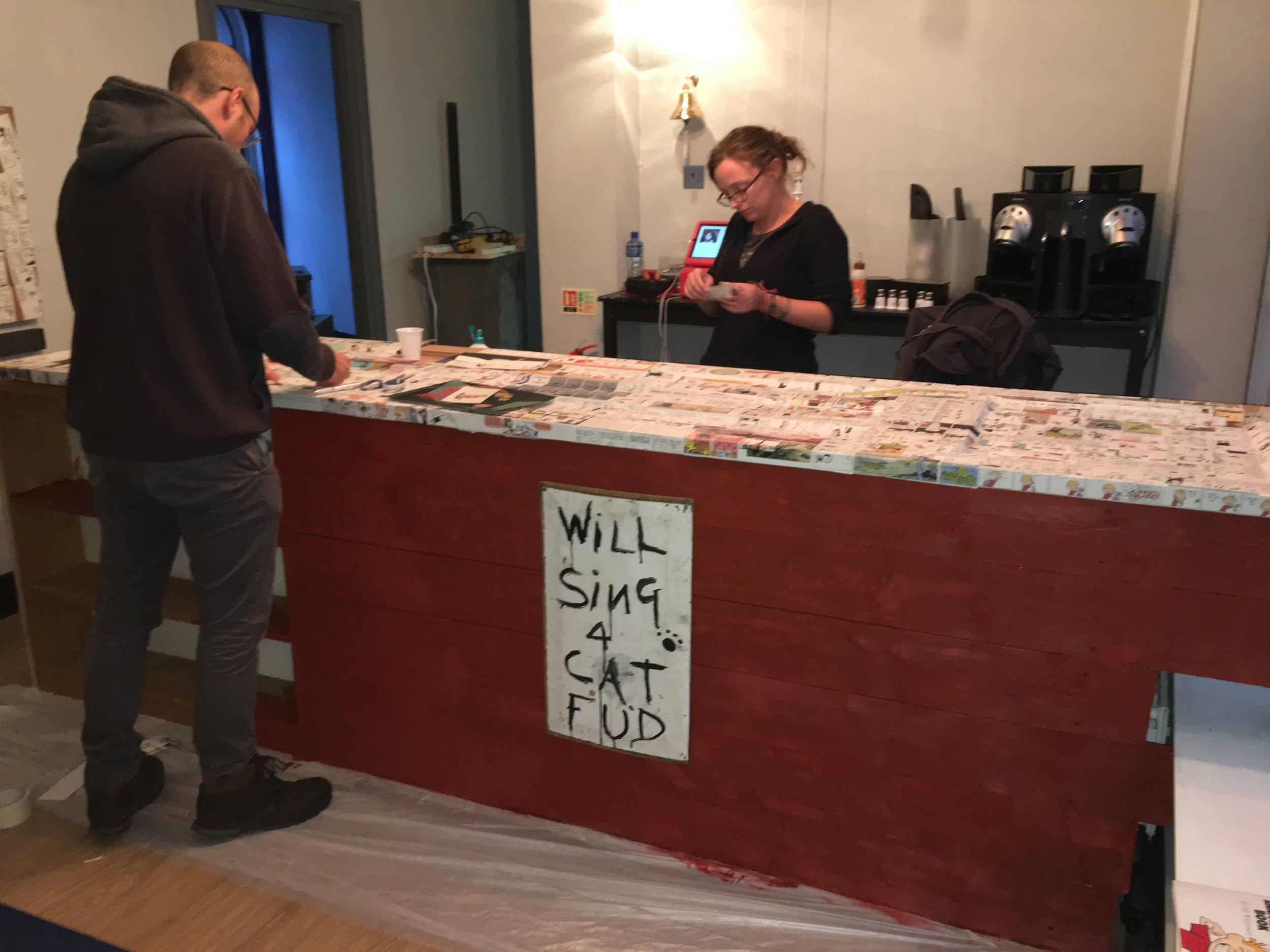 Teresa & John decorate the bar with Richard's Calvin & Hobbes cartoons