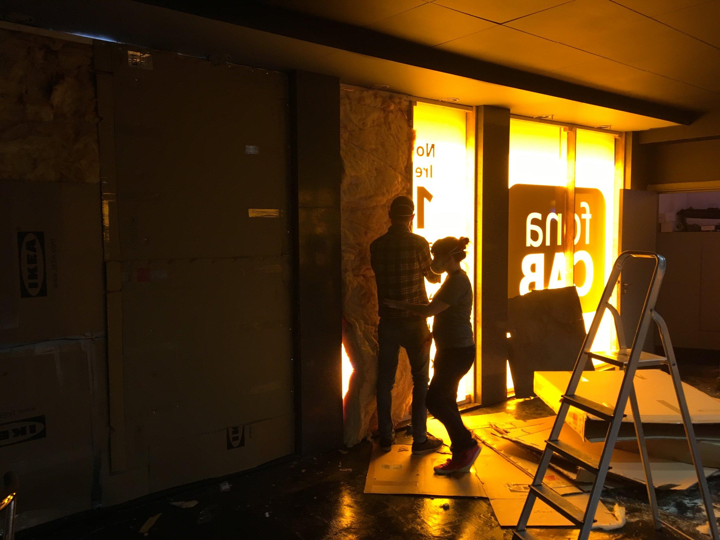 Gemma & David start insulating the windows in the theatre