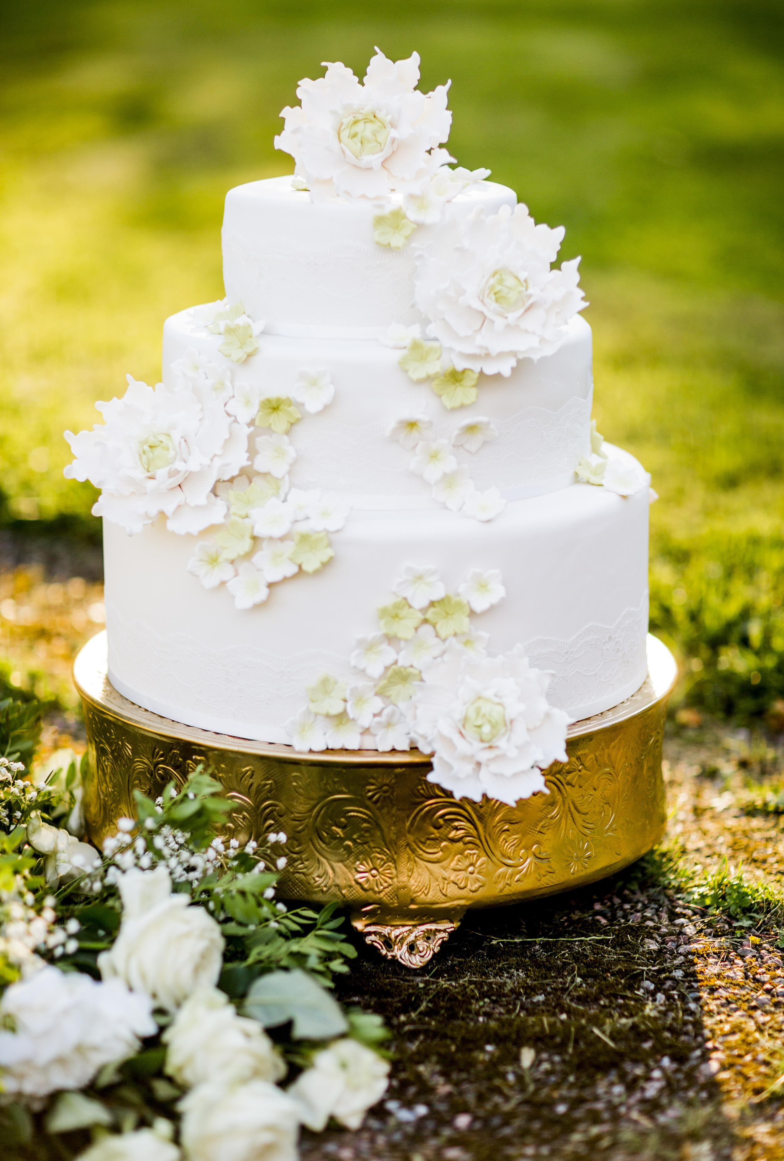 Bröllopstårta guld vit Wedding photographer