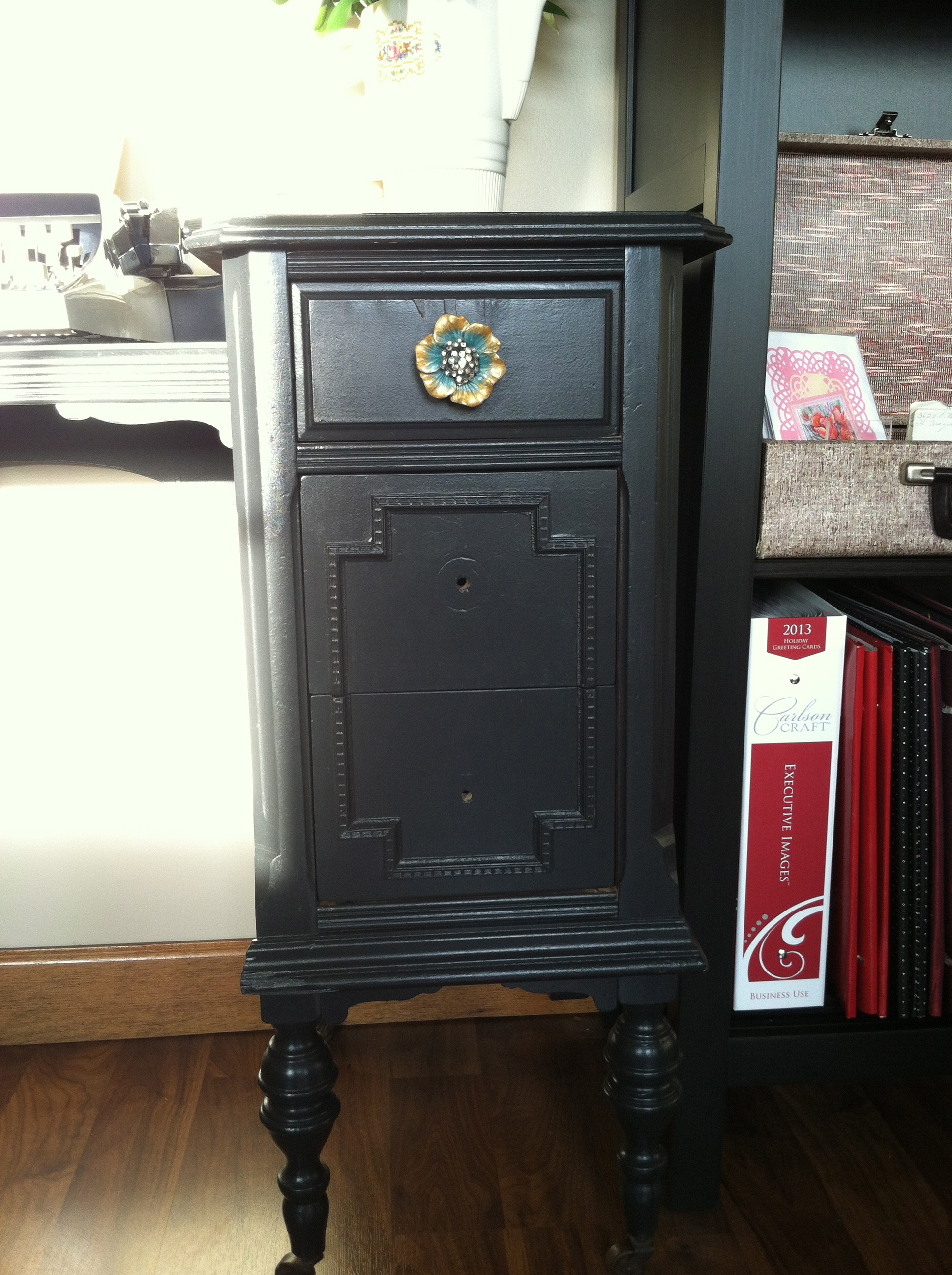 I painted this piece a safe and solid black and added the cute knobs. It needed something extra but I couldn't find the time to do it.