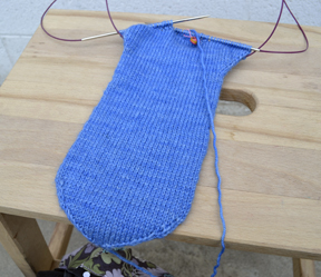 Sylvia is just starting to turn the heel on her Chiva sock.