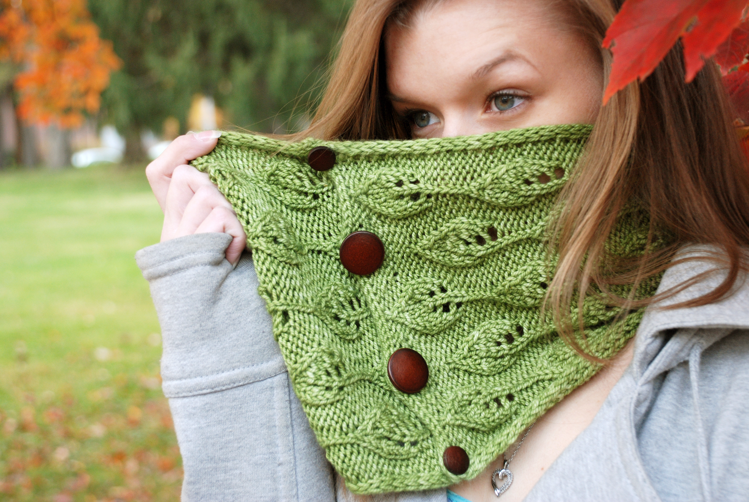 Embowed Cowl, knit in Cricket, shown in Pesto.